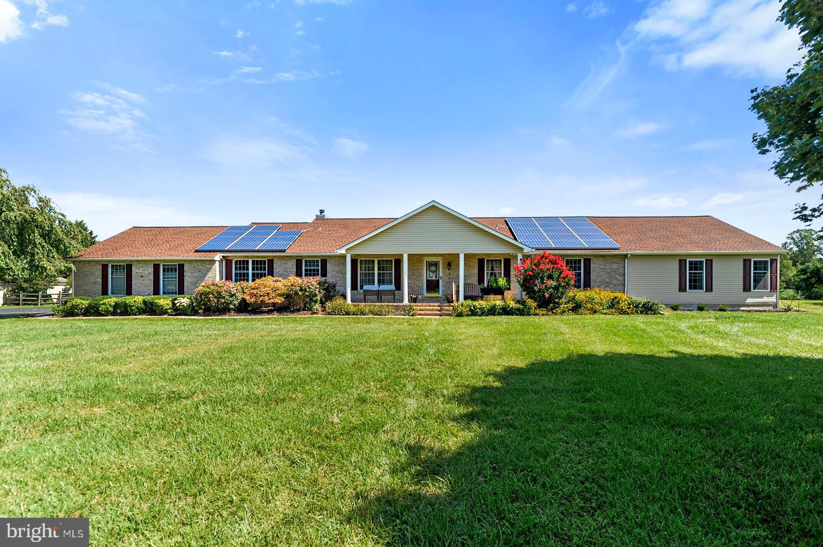Located in Award Winning Appoquinimink School District on 4.39 AC, this Brick Ranch Home is over 3000 sq. ft. with 3 BRs, 2.5 Baths and a Recently Added 32' x 25' Bonus Room/In-law Suite/Den!  This Floor Plan is So Versatile & Will Meet Many Needs.  The Bonus Room has a Bay Window Overlooking the Expansive Back Yard, Living Area w/Wet Bar and Large Walk-In Closet.  The Primary BR can easily fit a King-Sized Bed, Double Closets and Elegantly Remodeled Full Bath.  The other 2 BRs are also Good Sized with the 2nd Full Bath Recently Remodeled with a Large Soaking Tub & Shower Stall w/Seat.  The Kitchen has Solid Surface Countertops w/Breakfast Bar, in the past few years all new Stainless Steel appliances - Gas Stove & Built-In Microwave, Dishwasher and Refrigerator, Recessed Lighting & Large Breakfast Area.  The Kitchen Opens to the FR with HW Floors & Wood Burning Fireplace; French Doors lead to the 3-Season Room (w/replacement windows) which in turn Leads Out to the 2 Tiered Composite Deck and Patio.  The Formal LR has HW floors & a Bay Window w/Views of Lush Landscaping and Wildlife.  The Formal DR has Crown Molding, Wainscoting, and HW Floors.   Let's not forget about the Brand New Roof with Solar Panels!  Laundry Room w/Utility Sink, Overhead Cabinets, and a Door Leading to the Back Yard.  The Attached Garage is Enormous at 625 sq. ft., Service Door and Utility Sink.  The Paved Driveway has a Large Turnaround & Plenty of Room for Guests.  There is a Covered Carport with Concrete Base which can Fit 2 Cars.  In addition, there are 2 Sheds Both with Electric.  One is 28' x 16' w/1 garage door and the other is 14' x 10'.  Partial Basement w/Bilco Doors, Crawl Space with Concrete Floor, New Water Supply Lines, New Water Conditioner w/Reverse Osmosis.  Electric Service Panel Replaced  2017 and Generator Transfer Switch Added.  Fios available!   Quiet countryside location and just a few minutes away from Middletown and RT 1.