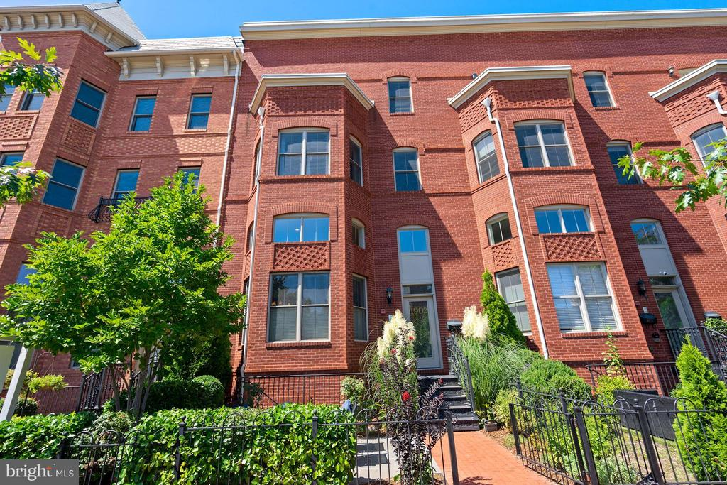 Great location, amazing house-like space in a well-built, traditional townhouse/condo built only 8 years ago. This 2,000+ sq ft townhouse condominium sits on the edge of three of DC's hottest neighborhoods: Shaw, Logan & U Street.  With 3 real bedrooms and an enormous media room/den/office/great room this home offers lots of space, but includes the added convenience of newly-built,  low-maintenance living & an attached garage.  On the first floor there is a gourmet kitchen, living room and dining area with double-height ceilings and loads of light.  The kitchen features a Sub-Zero refrigerator, a wine refrigerator, granite counters, lots of prep space, cabinets and drawers.  The first floor also includes a powder room and coat closet.  The upper level has one of the largest primary bedroom suites you've likely ever seen in Washington DC.  This serene enclave has an equally large walk-in closet, with a surprise additional storage space within - perfect for luggage, holiday decorations, etc.  The primary bathroom is ensuite with a walk-in shower, separate soaking tub, two separate vanities and sinks.  The lower level features a very large - yet cozy - tv room/great room, two additional bedrooms with full-sized windows and a second full bathroom.  The attached garage is accessed just half a level down from the first floor, has shelving for additional storage and a garage door opener with remote.  There is a private patio space out front, with just enough room to entertain friends and wave to neighbors.   The location couldn't be much better for the finest in-city living.  Within a few blocks you will find a new Whole Foods Market (Florida Ave) live music venues, and dozens of DC's best restaurants, bars & clubs.  The U St/African-American Civil War Memorial/Cardozo, Green-Line Metro Station is a mere 62 feet from the front door of 1902 Vermont Ave.  City-living really doesn't get much better or easier than this.