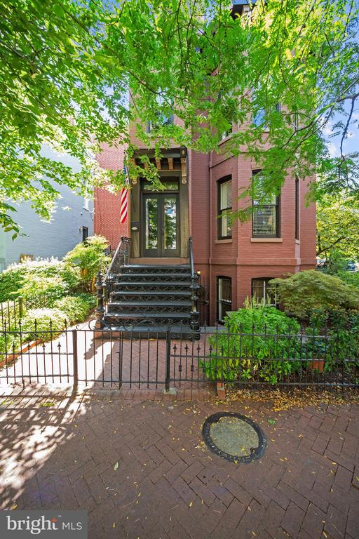 Located in the heart of DC's popular Shaw neighborhood, on a beautiful corner lot,  is 942 O St NW. This classic and elegant semi-detached  3 bedroom, 2 bath home has sun filled tall windows, gorgeous original hardwood floors, crown molding and pocket doors. Lovingly restored renovation includes newer kitchen and bath, central air and a very appealing separately metered  1 bedroom in-law suite with private entrance.  Upstairs are 2 bedrooms plus den/office.  Only 4 blocks to metro and an array of restaurants, boutiques, and ever popular eating and shopping mecca of City Center.
