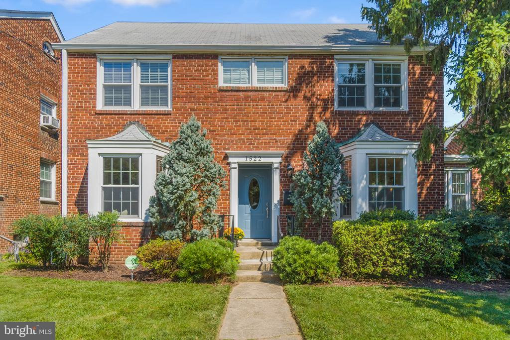 Charming all-brick detached home in Brookland, perched on a lush landscaped lot close to metro, restaurants and conveniences. Updated kitchen with stone counters, under-cabinet lighting and GE stainless steel appliances including a side-by-side refrigerator, 5 burner range, above range microwave (2021), dishwasher (2021), and disposal. Three big bedrooms and full bath upstairs, plus a guest suite with kitchenette, full bath, closet and separate entrance downstairs. The primary bathroom renovated in 2018 has Porsenalosa faucets, fixtures and contemporary tile, MTI tub,  and a Madeli floating vanity. Flexible living areas on the main level include a large living room with a fireplace and space for a table plus a large dining room off the kitchen that could also be used as a family room.  A sunroom adjoining the main living room is perfect for a home office or play space. A spacious deck off the living room and kitchen, plus a patio at ground level, extend your entertaining outdoors. Enclosed, climate controlled, former garage space with a utility sink is ideal for play, office, craft studio, or workshop, and could be returned to parking if needed. Laundry room with Bosch 800 washer/dryer and an extra box freezer (2018) that conveys. Gas water heater (2018).  A large, standing-height attic provides endless storage and provides options for expansion. A lush landscaped garden provides a quiet retreat and the rear driveway is long enough for 3+ cars parked tandem. Less than 1 mi. to Brookland - CUA metro. Walk to Primrose, Brookland's Finest, Masala Story, Yes! Organic Market and more.