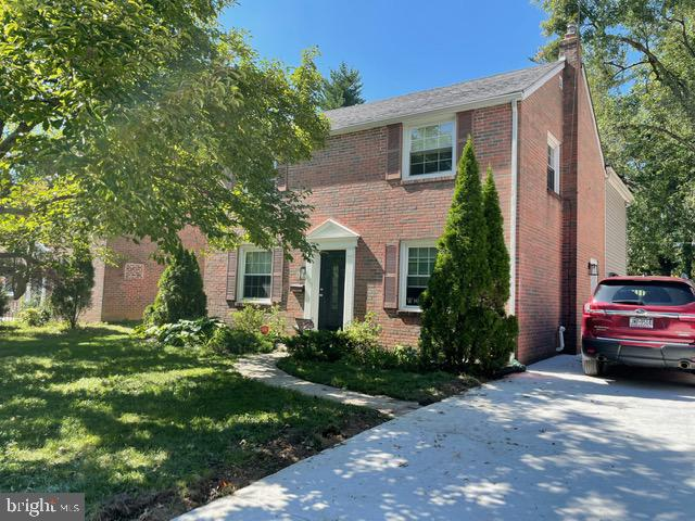 This expanded brick colonial in Lower Merion School District is conveniently located close to parks, shops, and restaurants in the historic neighborhood of Ardmore!  The ideal location also allows for easy access to the SEPTA regional rail, high speed line and I-476.  The spacious first floor has hardwood floors throughout.  An open kitchen and family room has direct access to an EP Henry patio with outdoor fireplace and fenced-in yard.  A side entrance to the mudroom includes a powder room and laundry area.  Upstairs are 4 bedrooms with hardwood floors and a full hall bath.  The master suite features 10-foot vaulted ceilings, two walk-in closets and a magnificent view of the backyard along with a bathroom that includes double sinks, a soaker tub and frameless glass shower.  A partially finished basement allows for additional family living space and bonus storage.
