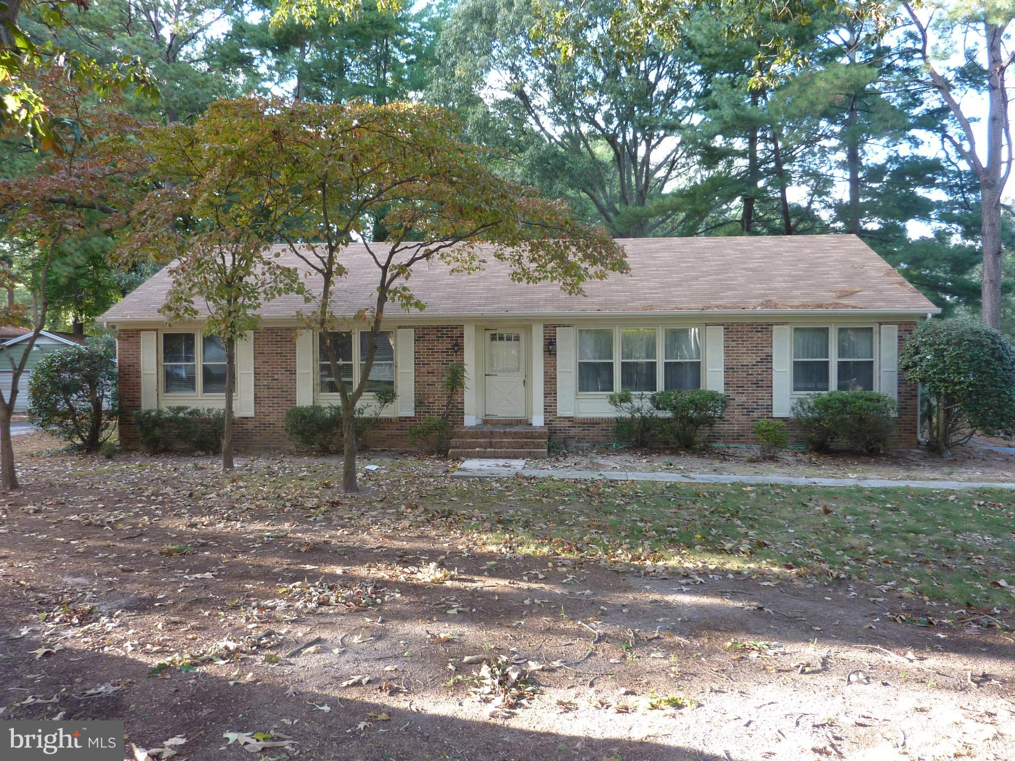 APPLICATION REQUIREMENTS: Excellent rental history, income $5,000+/mo, & Experian FICO 650+.  Sprawling rancher located off Loblolly Lane, near Salisbury University. The entry hall opens to the front living room, separate dining room with built-in corner display cabinets, peninsula kitchen with pantry and full appliances, family room with a brick fireplace, sun room with sliding doors to the back yard, and laundry room with washer/dryer hook-ups and storage cabinets. All three bedrooms have ceiling fans and carpeting, and the master bedroom has two closets and a full bathroom. Appliances include refrigerator, electric range, range-hood microwave, and dishwasher. Features include oil heat and central air conditioning, a paved driveway, and ceiling fans throughout. Tenant is responsible for lawn care and utilities (electric, oil heat, water/sewer/trash). Ready for move-in.