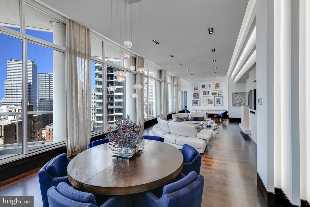 """A BREATH TAKING ARCHITECTURAL MODERN MASTERPIECE! Introducing Residence 1901 at THE RITTENHOUSE HOTEL & CONDOMINIUMS! Unique One-of-a-Kind, Designer, Residence with BALCONIES! 3 Bed, 2.5 Bath, 2954sf Condo with 5 YEARS REMAINING ON TAX ABATEMENT! Your attention is immediately drawn to Western Sunset Views from the soaring 14' Ceiling Heights. The Architectural Modern detail from the Slatted Walls to the intricate ceiling design...this home is a must see! The 19th floor is the ONLY floor in the Rittenhouse with 14ft Ceiling Heights and numerous BALCONIES FROM EVERY ROOM!  Enter through the Spacious Foyer into this Open Floor Plan with custom Recessed and Cove lighting through out. Custom-Built Powder Room is discretely located off the Foyer. Large Laundry Room with Additional Storage. Electric remote controlled window treatments at every window are Programmed to enhance the morning views and afternoon sunlight. Throughout this Designer home are SieMatic Cabinetry in Kitchen, Baths, and Living Room. Customized SieMatic built-ins adorn the LIVING ROOM which leads to the DINING ROOM large enough to seat 20+! A fabulous home for ENTERTAINING and cocktails as you view the sunset. Open Kitchen with top-of-the-line appliances and Floor-to-Ceiling custom SieMatic Cabinetry and Large island w/ Casesarstone  Countertops. The MAIN BEDROOM SUITE is a serene oasis with customized walk-in closet along with exquisite en-suite MAIN BATH featuring Floor-to-Ceiling """"Cristallo Extra"""" Quartzite and Shower for 2! A Duravit Self-Cleaning Camode adds to the Spa-like features. This split floor plan features 2 additional bedrooms on the opposite end. 1 Bedroom is currently used an IN-HOME OFFICE. And did we speak about the ample amount of CLOSETS!? Storage custom-fitted closets are nestled throughout this home. ONLY 3 CONDOS ON THIS FLOOR - Privacy is all yours! All Services and Amenities of The Rittenhouse Hotel are available: Chauffeur-driven Town Car, Room Service, Housekeeping, Doorman, """