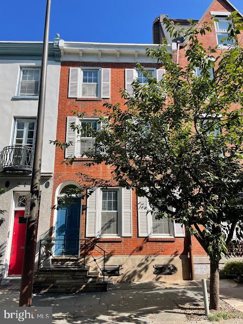 Welcome to 2111 Locust St. blocks from Rittenhouse Square on one of the most Historic streets in Center City Philadelphia.  Enter into spacious, open floor plan with high ceilings, abundant natural light and functional flow.  Large living area with powder room, separate open dining area and efficient kitchen with small shared outdoor space. Second level offers a den/office, large hall closet,  large master bathroom and master bedroom. Third level offers 3 bedrooms and a shared hall bath. Healthy closet space, good bones and ready for your architect and/or designer!  Lower level partially finished. Greenfield catchment. Close to major retail, restaurants and historic sites. Don't miss this opportunity to turn this house into your H.O.M.E.