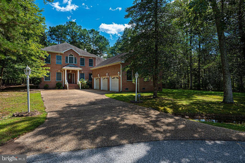 Check out this custom built home by T&G builders located in the Sanctuary of Ocean Pines.  Large, almost 5000 square foot home with lots of thought put into the design and layout.  Primary bedroom and full bathroom on each floor, two-sided gas fireplace creates an amazing ambience, large deck off the back overlooking the stream and equipped with a full bathroom making those crab feasts an easy cleanup.  The house is adorned with hardwood floors, kitchen has granite countertops and stainless appliances, cathedral ceiling in the living area, large bedrooms, loft area, walk in closets, and views of the water from many windows.  You can also store all of your cars and toys in the attached, 3 car garage.  You have to see this one in person to truly see all it has to offer.