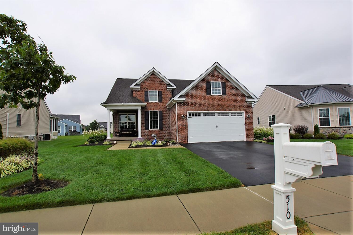 Celebrate the rare opportunity to own the first model home built in this highly regarded 55 plus community of Champions Club.  This model home has all the options, exquisite woodwork and details a high-end model home always features.  Beginning with its unique brick façade, you'll enjoy multiple outdoor living spaces beginning with the stately pillared covered front porch and including the rear screened porch and maintenance free deck.  The elegant entry boasts a transom window above the leaded glass door and side windows.  Hardwood flooring covers the first floor living spaces with extra width floor and crown moldings and detailed wainscoting providing additional embellishment.  Alluring ambiance is provided by the double-sided glass fireplace that links the living room and dining room areas.  Your gourmet kitchen has quartz  countertops, stainless sink, breakfast bar, tile backsplash, expansive wood cabinetry with periodic glass cupboard doors, under cabinet lighting and newer appliances.  Adjourn to the family room that includes walls of windows and a double sliding glass door with muntins and transom window leading to the screened porch.  The master is on the first floor and the second floor bathroom enjoys its own personal bathroom.  Three bedrooms and three bathrooms….another rare find in this established community.  Enjoy membership in the clubhouse located conveniently right across the street with Olympic size outdoor pool, workout room, pool hall, and multiple elegant meeting and party areas available for your use.  You'll have a cost-effective ownership experience as this is a GREEN home that includes an $8,000 owned water softening system, conditioned crawl space for storage, insulated garage door, SMART thermostat facilitates remote programming, furnace and HVAC less than three years old and features eco-friendly refrigerant with a high SEER rating and more.  It's your dream home come true!  Visit quickly…unique residences do not last long!