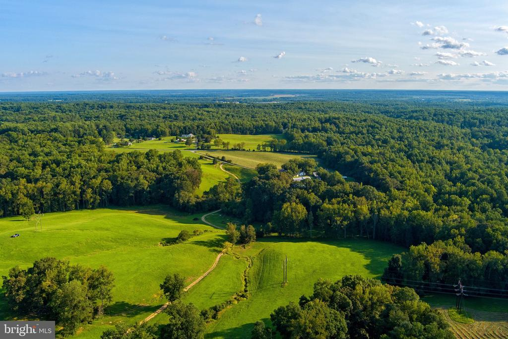 GORGEOUS land that is full of endless possibilities. The panoramic views of gorgeous pastures is bound to wow you. Whether you. are a farmer, developer, or just someone that wants to build the most amazing house and sell off land later; this is your chance! These incredible pastures are truly one in a million. Don't believe me?  Drive by and take a look for yourself!!