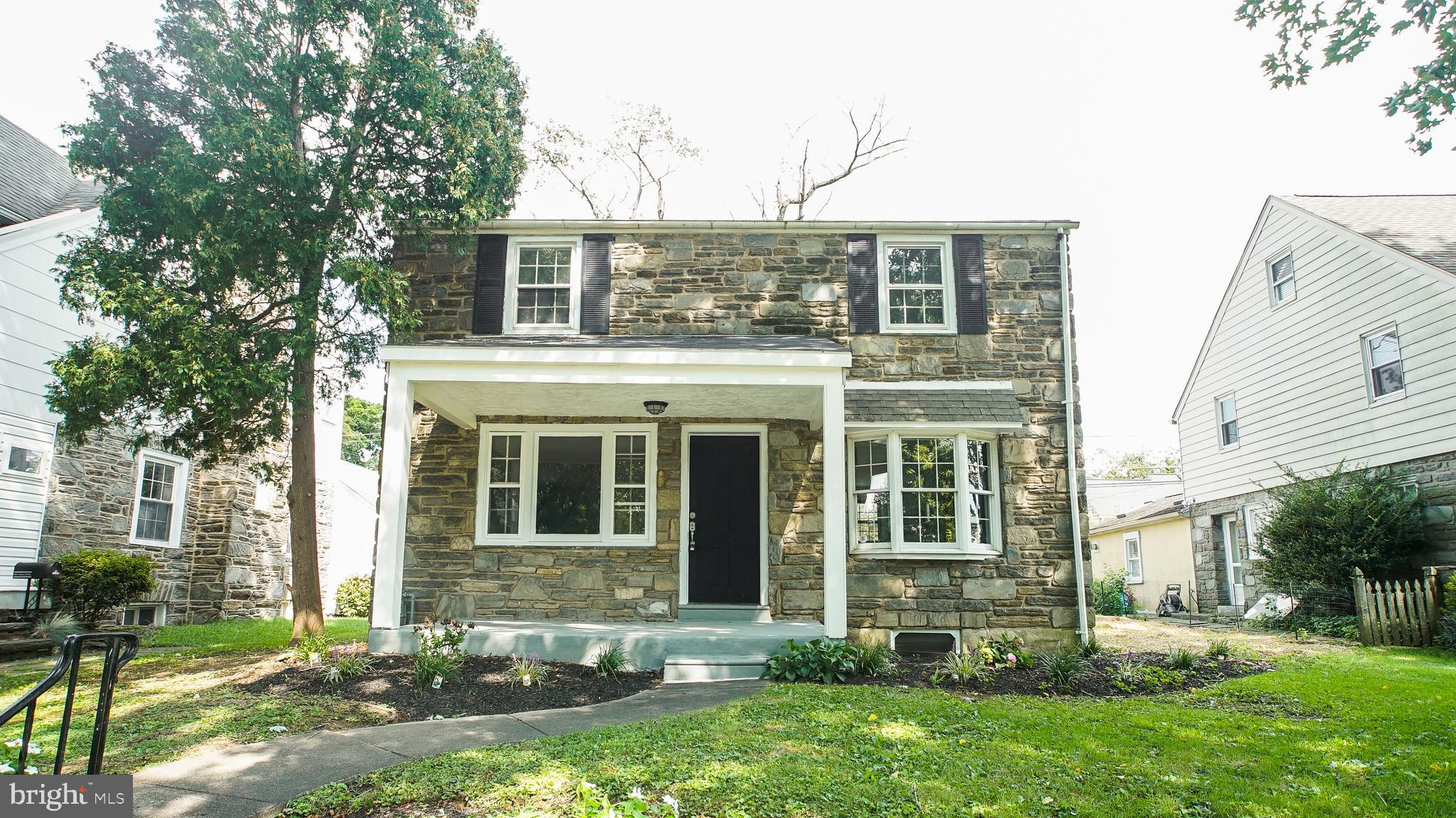 Have you dreamed of living in Lower Merion School District but haven't had the right opportunity? Now's your chance! Come check out this recently renovated 3 bed, 2.5 bath home waiting for you! This stone gem, located on a quiet street, greets you with plenty of curb appeal and fresh landscaping. Walking up onto the concrete porch, you are sure to envision drinking your morning coffee here! Heading through the front door, you enter the living room brimming with tons of natural light. There is also a fireplace, and beautiful hardwood floors and recessed lighting throughout. Through the living room, there is a sitting room, with plenty of storage and a large, picturesque window. To the right of the living room is a formal dining room, complete with hardwood floors and a large bay window. Heading into the generously sized kitchen, with granite countertops, there are endless storage possibilities, counter space, and tile flooring. There is also access to the backyard, including a driveway. The first floor also features a half bathroom. There is also additional space, with a half finished basement, and full bathroom. Heading up to the second level, there is a large master bedroom, and 2 other spacious bedrooms, along with a full sized hall bath.  There is also a 300 sq ft basement, perfect for storage, or to create into a finished project! The hot water heater is also only 2 years old. Located close to City Ave and all it's shopping and dining amenities, what more could you want! Check this out today before it's gone!
