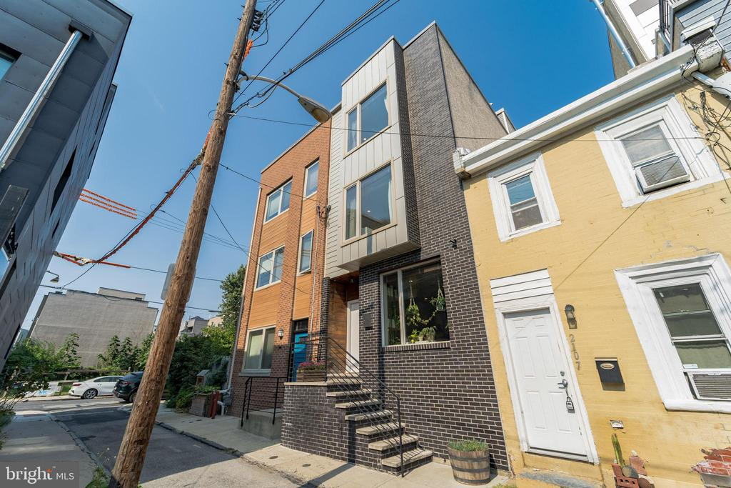 Don't miss this pristine, well-finished townhome in the wonderful community of Fishtown! This 3 bed and 2.5 bath home features 2,185 sq ft of naturally lit living space. The home faces Southwest with no building directly across it, thus offering tons of natural light to pour into the home. Enter the main living area and notice gleaming bamboo flooring and recessed lighting throughout. The living room, kitchen, and dining room flows seamlessly into one another giving that sense of luxury and space, a great feature to this beautiful home. Notice the built-in shelves in the living room, beside the modern metal & wood staircase, it is a perfect spot to display indoor plants or ornaments. The kitchen creates great meals with its stainless steel appliances, granite countertops, center island, charming tile backsplash, and dazzling cabinetry. It opens up to the fully fenced backyard through glass sliding doors. This modern open layout provides a great entertaining space. Move your way up to the second floor showcasing 2 lovely bedrooms sharing a full hallway bath with massaging jets in the showers. The primary bedroom takes up the entire 3rd level, and features a large walk-in closet in the master suite, as well as access to the full length roof deck with city views. There is a glass door shower and dual sink vanity and a large jetted tub with tile surrounding it, perfect place to enjoy a relaxing bubble bath. Downstairs, the basement offers additional living space, plenty of space for storage, and features a laundry area. Designed conveniently in this level is also a half bath. The nice and quiet backyard provides a wonderful space for alfresco dining, pot gardening, and more! 2105 Abigail Street brings you close to countless restaurants and coffee shops including Forin Cafe, La Colombe Coffee, Suraya, Pizzeria Beddia, Riverwards Produce, and many more! You will have easy access to I-95 and Center City via Market Frankford Line Subway which is less than 5 min walk. There 