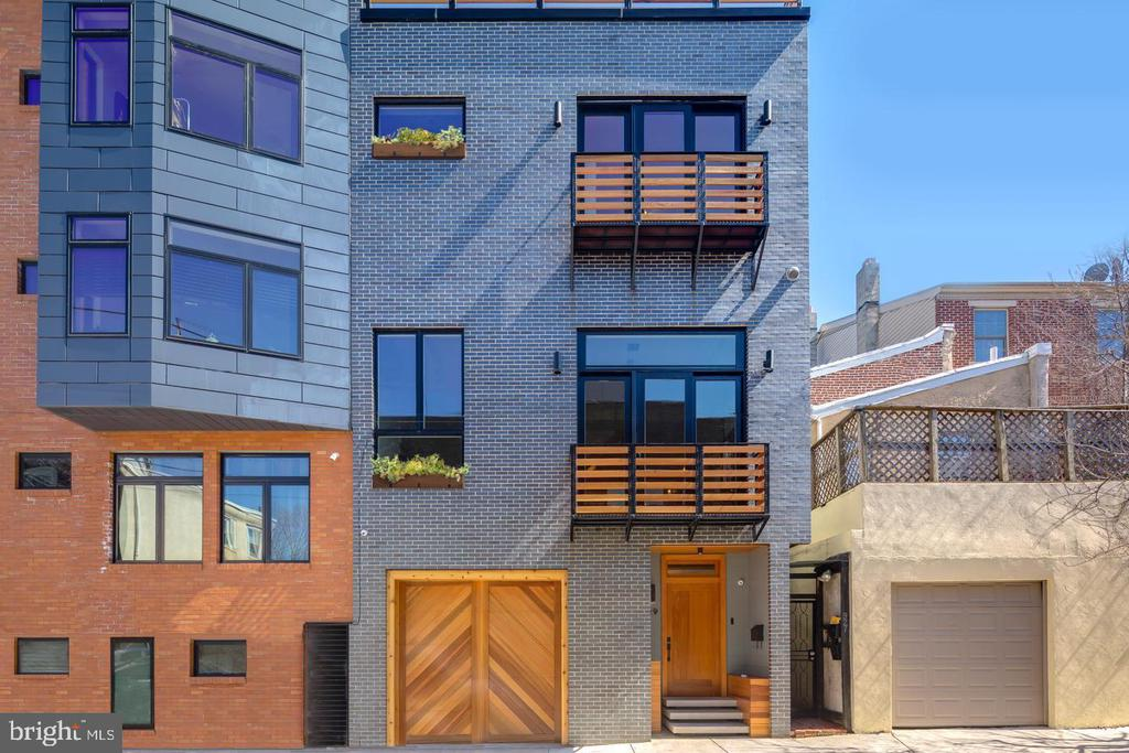 Wow!! When opportunity knocks!! This Stunning newer construction 24 foot wide home, nestled on a residential street, only blocks from all of the Northern Liberties action, has everything a savvy consumer could want! This LEED PLATINUM abode boasts almost 4000 square feet of living space, 6 years left of a 10 year tax abatement, 4 bedrooms, 4 and 1/2 sumptuous bathrooms, multiple living spaces, it is completely automated and has an extra large garage. Automation includes Nest Learning Thermostats, Nest Hello Smart WiFi Video Doorbell, Nest Yale Lock - Key-Free Smart Deadbolt, Phillip Hue Smart Light energy efficient LED lighting, Nest Smoke & CO2 detectors and many more state-of-the-art luxuries. Located in quite possibly the most desirable neighborhood in the city, Northern Liberties, this home is an elegant work of art and truly raises the bar for high end luxury living. Off the rear of the home is an amazing custom landscaped private & spacious rear yard/ enclave with expertly-selected native plant arrangements, built-in benches, and a walk-up to a 2nd level deck. Inside the home, the amenities continue to elevate. The pristine, modern kitchen is highlighted by Adornus custom cabinetry, Bertazzoni appliances, an over-sized island with breakfast bar, custom light fixtures imported from Greece, built-in Smart television and a formal dining area. Access to the 2nd level deck can be found in the spacious, open living area which boasts high ceilings, effusive natural light, and beautiful natural Red Oak hardwood floors that continue throughout the home and staircase landings. All of the spa inspired bathrooms have motion sensor lighting, Grohe fixtures, Carrera marble floors, and Blossom vanities. The laundry room has LG front-load washer & dryer with matching pedestals The expansive roof deck is highlighted by incredibly captivating panoramic views and also includes daylight-timed LED lighting. Tons of natural light, huge ceiling heights, multiple dens/ offices, room 