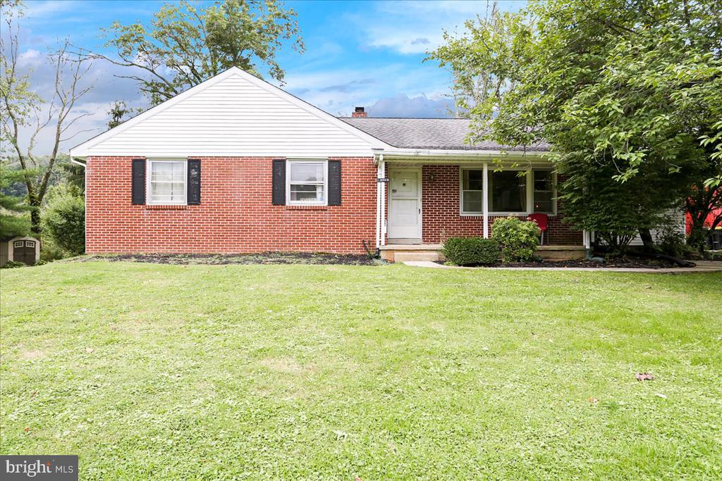 Welcome to this well kept ranch in beautiful Boyertown! Quite the opportunity with this home! This home features 4 good size, fully carpeted bedrooms  with beautifully remodeled center hallway bath! Large kitchen with breakfast nook has sliding glass doors to back deck. Separate formal dining room boasts beautiful built-ins and has room for 12. Harwood floors in the large front living room continue throughout the homes main living areas.  Full walk-out basement could be finished and includes a finished full bathroom and large stone wood fireplace.    This ranch has been upgraded with EXTREMELY efficient,  TOP OF THE LINE 19 Seer inverter central air system AND a