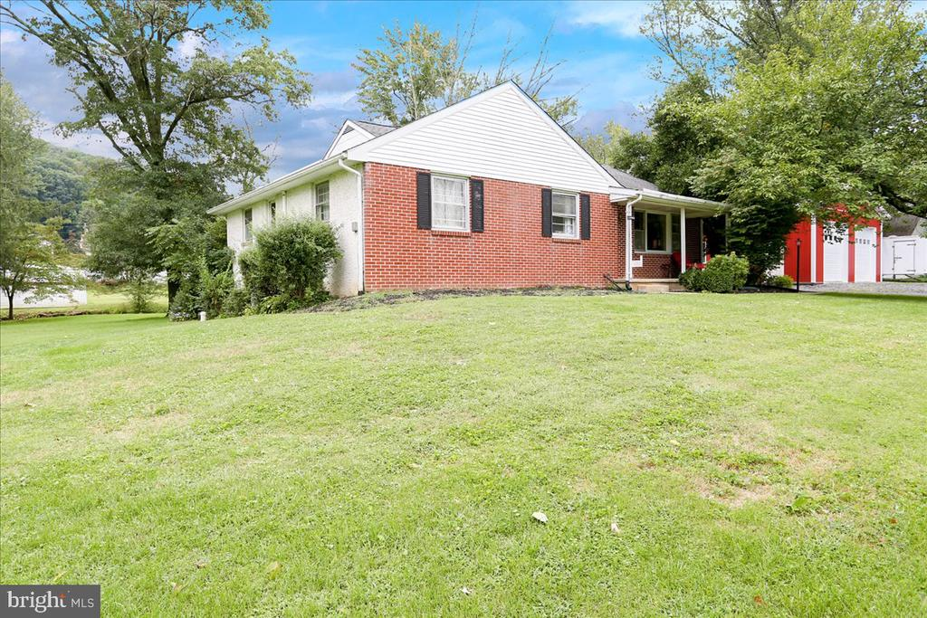 Welcome to this well kept ranch in beautiful Boyertown! Quite the opportunity with this home! This home features 4 good size, fully carpeted bedrooms  with beautifully remodeled center hallway bath! Large kitchen with breakfast nook has sliding glass doors to back deck. Separate formal dining room boasts beautiful built-ins and has room for 12. Harwood floors in the large front living room continue throughout the homes main living areas.  Full walk-out ( DRY ) basement could be finished and includes a finished full bathroom and large stone wood fireplace.  This ranch has been upgraded with EXTREMELY efficient,  TOP OF THE LINE 19 Seer inverter central air system that will have your cooling costs at a minimum! A 30 x 40 HEATED Pioneer Pole barn was also added to this property for whatever kind of workshop you could hope for! You must come see!