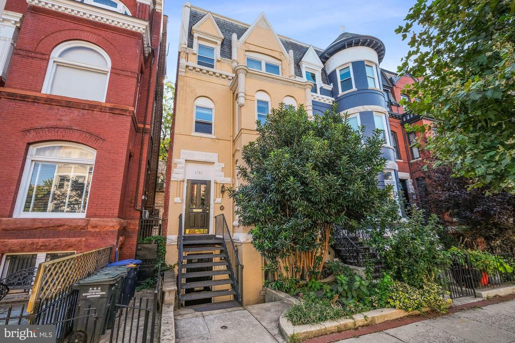 Here's an opportunity for a classic four-story Victorian home with two complete residences within, perfectly located in the heart of Dupont Circle. Live in one, rent the other, or rent both! Built in 1912, this beautiful row house presents magnificently from the street with its dramatic front bays, exquisite cornice work and an absolutely stunning roofline. Step inside and you'll discover a multitude of possibilities. In recent years, it has served as an excellent investment property with a terrific rental history. But it could also be someone's dream residence across all four levels. There are four bedrooms, 3.5 baths and nearly 3,000 square feet of space, with hardwood floors, a large private patio off the lower unit and a tremendous private treetop deck on the upper unit. With updated kitchens and baths, redone main level hardwoods, and two sets of washers and dryers, this historic structure offers a great blend of old and new. Stroll to great restaurants, museums, the Metro, Dawson's Market, Dupont Market, Lauriol Plaza, Safeway and Whole Foods, Vita Fitness, to name a few, not to mention the circle itself as a community gathering spot.