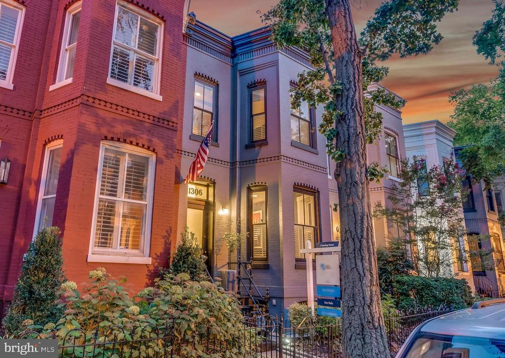 Beautifully renovated rowhouse with a private patio and parking in the ideal Logan Circle location! Located on tree-lined Corcoran St NW, you'll love the welcoming curb appeal with an area for a city garden and updated exterior paint. The main level of the home features hardwood floors, tall ceilings, cozy fireplace, powder room, and large dining area. Enjoy preparing meals and entertaining in the updated kitchen featuring stainless appliances, granite counters, gas cooking, and ample cabinet space. Off the back, head down to your private flagstone patio with updated landscaping. Behind the patio is easy access to your RESERVED PARKING SPACE! Upstairs, relax in the spacious primary bedroom with great closet space and natural light, plus a spa-like en-suite bathroom. There's also an additional bedroom with a full en-suite bathroom and separate den that could easily be enclosed to be used as a third bedroom or nursery! The lower level has amazing rental potential with both interior and exterior entrances. You're just steps to some of DC's most popular restaurants including Le Diplomate, Pearl Dive, Jane Jane, and Mexicue. Not to mention you're also very close to the NEW Amazon Fresh, Whole Foods, VIDA, Starbucks, local parks, and so much more! Professional photos coming soon.