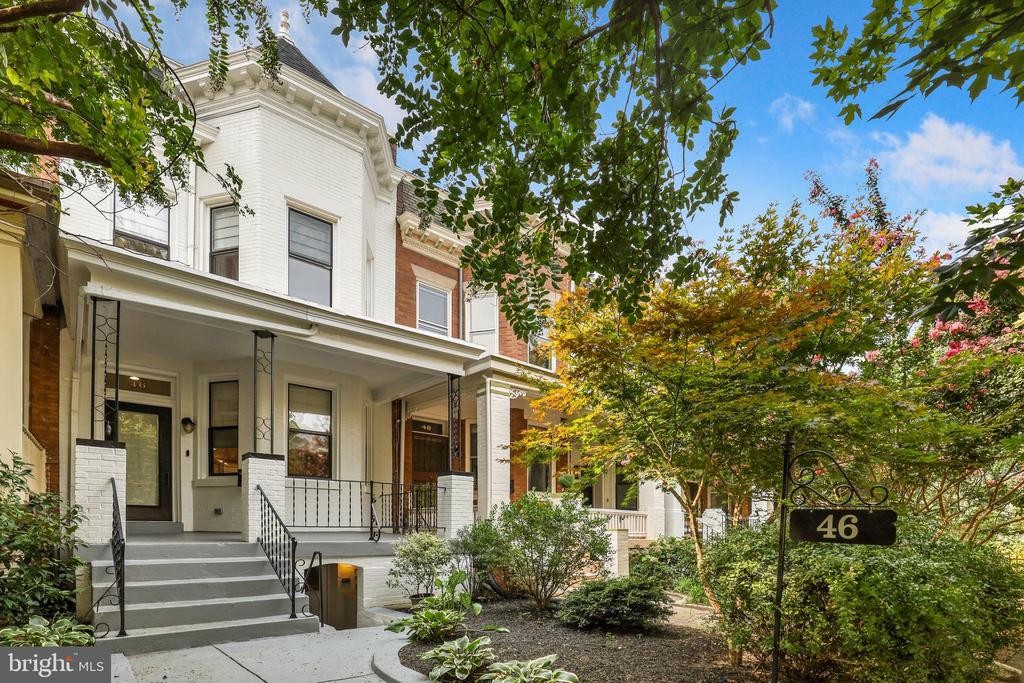 Welcome to this beautifully updated 4 bedroom, 3.5 bath row home on a quiet, leafy block in sought after Bloomingdale featuring an income generating lower level apartment and secure parking!  Recent updates with high end finishes include new bathrooms, kitchen appliances, all new doors and hardware, new light fixtures, refinished floors, and exterior paint. This home has been meticulously maintained with a new warrantied roof and skylight. All pipes are non-lead (both public and private lines).  The front porch greets you and invites you to sit down, relax, and enjoy your morning coffee while overlooking the landscaped front yard.  Step inside and appreciate the 12' ceilings, custom window treatments, and windows throughout drenching this home in natural light.  The gracious and open floor plan is designed for easy entertaining.  The spacious living area is accented by an exposed brick wall, crown molding and tons of recessed lighting.  Transition easily to the dining room.  Celebrate your inner chef in the gourmet kitchen which boasts new Viking and Bosch appliances, plenty of cabinetry, granite countertops, tiled backsplash, gas cooking, and a shiplap styled breakfast bar for flexible dining and entertaining.  A brand new powder room and washer/dryer are conveniently located on the main level.  From the kitchen, step out onto your deck for dinners al fresco.  This home distinguishes itself in particular by a large backyard with a new privacy fence, which is perfect for kid's playtime, pets, and socially distanced entertainment.  The new slate patio is roomy enough for furniture inviting guests and owners to linger while enjoying the backyard.  Behind the backyard, is a parking pad for two cars with a roll up security gate.  Upstairs, three well-proportioned bedrooms await.  The primary bedroom suite features a bay window, Elfa closet system, recessed lighting, and a newly renovated en-suite bathroom with dual vanities and crisp tile.  A secondary bedroom showcases