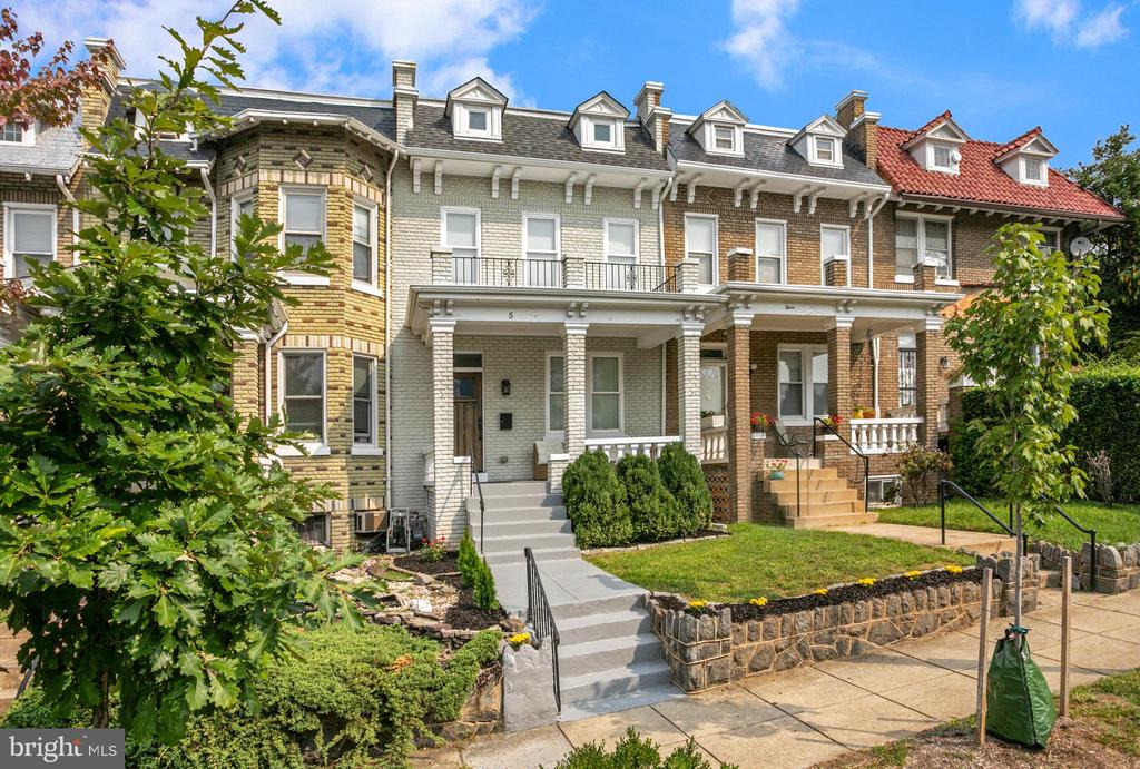 OPEN HOUSE SUNDAY 9/19 from 1-3PM - In the heart of vibrant Bloomingdale this classic front-porch Colonial Wardman row-home offers the quintessential DC lifestyle in a turn-key package. Recently renovated and meticulously maintained, this 4 bedroom, 3.5 bath home is quiet, sunny and located across the street from the coveted Crispus Attucks Park. The main level boasts an open floor plan including a welcoming living and dining area, a coat closet and powder bathroom. The spacious kitchen enjoys marble countertops, a large island with room for bar seating, natural gas cooking and an abundance of storage. Upstairs the owner's bedroom boasts an impressive double-height ceiling with multiple skylights,  southern tree top views, an exposed brick accent wall and a large walk-in closet. The owner's bathroom includes a double sink vanity, marble tile floors and surround along with a linen storage area. On this level there are two additional bedrooms, one full bathroom and the conveniently placed washer and dryer. The lower level, with interior and rear access, includes tile floors throughout, a separate living space, bedroom and full bathroom. Secure parking included. Neighborhood favorites like Red Hen, Bacio Pizza, Boundary Stone and Big Bear Cafe are a short walk from the home.