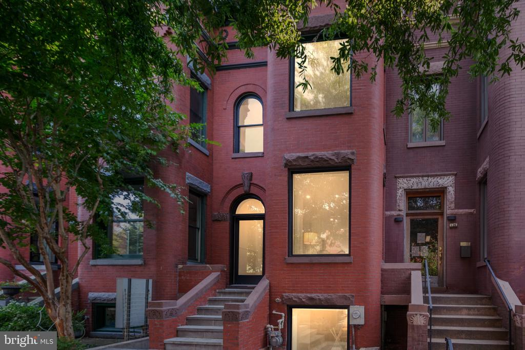 """There are homes in Bloomingdale, and there are homes in BLOOMINGDALE! Very rarely does a turn of the century rowhome of this magnitude come to market in this neighborhood. Renovated in 2019/2020, 122 Seaton Place NW is the perfect combination of well-preserved exterior character with all of the upgrades of contemporary luxury living. Located on a beautiful tree-lined street, this distinctive home features 7"""" wide solid white oak floors, a custom solid white oak staircase w/ glass rails, WOLF/SubZero appliances, a custom cedar sauna, imported Iznik tiles and heated flooring in the baths, a new AC system and roof, a rebuilt fireplace with new chimney liner and exhaust, and many more stunning upgrades. This is the one you have been waiting for!"""