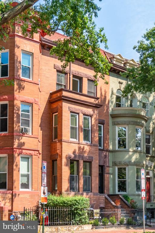 PUBLIC OPEN HOUSE SAT 9/18, 1-3 PM This spacious 3 story brownstone with separately accessed lower level apartment enjoys all the amenities of urban life in the heart of Logan Circle. 95 Walk Score and Biker's Paradise! The house retains many of its original gracious features - high ceilings, hardwood flooring, historic trim and molding details, charming fireplaces - and is updated by a more open floor plan that is flooded with natural light via a skylit central atrium and oversized double hung windows. A front, gated patio welcomes you to the property. The main level includes a proper entry foyer, large front sitting room, dining room separated by pocket doors, powder room and newly renovated kitchen. Off the kitchen is an enclosed deck perfect for grilling and dining al fresco. Upstairs is the primary suite with hardwood floors, walk in closet and large primary bath, including separate tub and shower, and stacking washer and dryer. The front room makes a perfect den, office or bedroom with charming window seat and custom built ins. The top level includes two additional bedrooms, front with private balcony and most recently used as an office, and rear with newly-to be installed Berber carpet, as well as a full bath. The separately-accessed lower level (with front and alley access) includes a full kitchen, generous living area, bedroom suite and large storage space with additional laundry facilities. With easy access to all the vibrancy of the Logan/Shaw/Dupont neighborhoods, and a generous floor plan able to accommodate working from home, comfortable daily living and more extravagant entertaining, this property is a special opportunity for spacious, elegant living in the heart of Nation's capital.