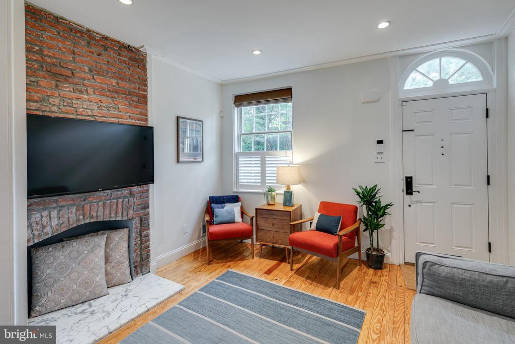 """Built in 1831 and updated with modern amenities, here is an opportunity to own a beautiful piece of Philadelphia history in Queen Village.  This home reflects all of the charm and character that goes with a neighborhood so steeped in cultural history.  The tucked away location, with a walk score of 89, is even more special considering that it is located in the Meredith School Catchment.  The 1st fl has a living room with a decorative brick fireplace and custom built bookshelves, an open dining room with a built-in desk, a powder room and an open kitchen with 42"""" cabinets, granite countertops, stainless steel appliances, breakfast bar, several pantries and a slate tile floor.  The 2nd floor has a bright and cheery bedroom and an updated bathroom with a double sink vanity, exposed brick accent wall, tub with subway tile and two closets.  The larger closet has a washer and dryer hook up.  The entire 3rd floor is the primary suite and feels like a private retreat.  The bedroom is beautifully designed with vaulted ceilings, exposed beams, a barn door and another gorgeous brick fireplace.  The bathroom is spa-like with heated floors and a shower with marble accent tile and a rain shower and handheld shower fixture.  The bathroom also has a marble top, double sink vanity with a subway tile accent wall, a Toto toilet and leads to the custom walk-in closet.  This home has 3 separate outdoor spaces: the covered balcony off of the primary suite, the side alley and a large deck with maintenance free Nexan decking with LED ambient lighting.  This deck is situated in the treetops and perfect for outdoor entertaining.  The basement has high ceilings, a laundry area and offers plenty of storage.   There's more: gorgeous pine floors throughout, high ceilings, lots of light, Nest thermostat, updated mechanicals and a tankless hot water heater.  The garden across the street has been maintained by the neighbor for close to 30 years. Great location! Two blocks from the Mario Lanza Park """