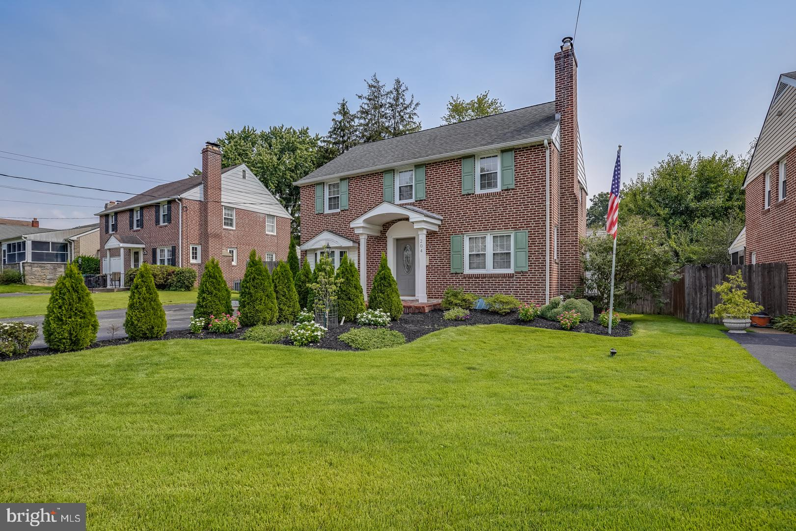 This lovely brick colonial in conveniently located Lancaster Village has a floor plan that just keeps going and going! The main floor features a formal living room with fireplace with wood stove insert that opens to a spacious dining room; a gorgeous updated kitchen including custom cabinets, granite countertops, hardwood floors, stainless steel appliances, slide-in gas range with convection oven, and a convection microwave oven; a massive great room with large windows, a gas fireplace, and an updated powder room; a charming laundry room; a sunny office or play room with bay window and window seat; and a gorgeous screened-in porch with bar and brick patio that are perfect for entertaining! Upstairs you'll find three large bedrooms, an enormous full bathroom with clawfoot tub, shower stall, double vanity, and tile floor. Head to the basement for a finished area that can be used for crafting, a play room, or just additional space to store all of your treasures!  Conveniently located between Lancaster Pike and Kirkwood Highway, you will be near everything you'll ever need - shopping, dining, entertainment, libraries, and many of the areas best schools. Schedule your tour today!