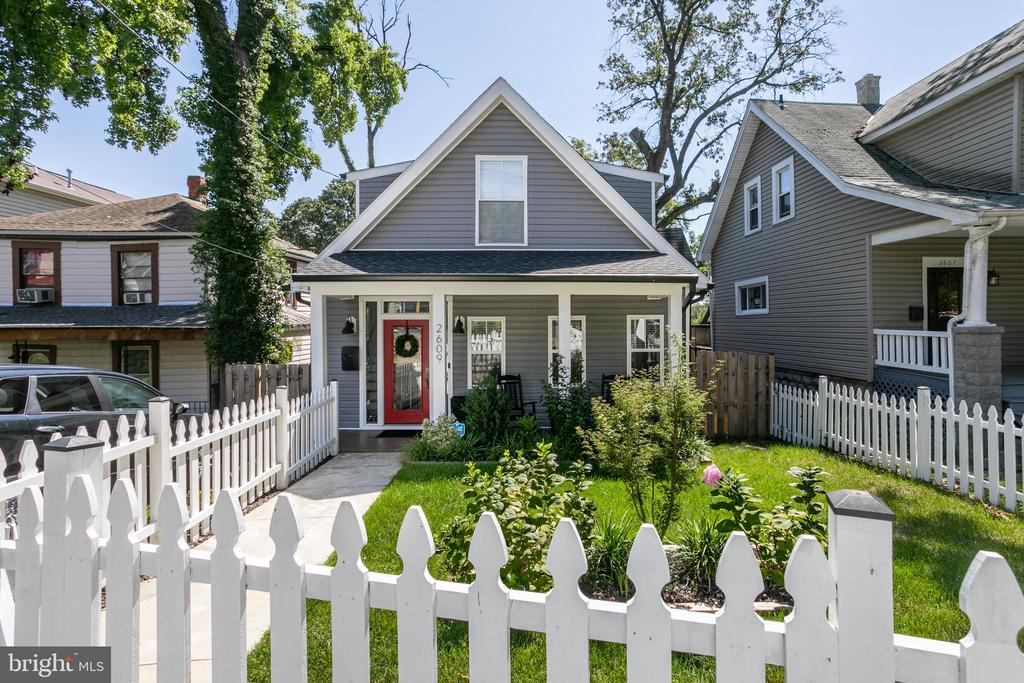 """Renovated in 2019, this modern farmhouse says, """"Welcome Home"""" with its white picket fence and beautiful landscaping. The covered porch is the perfect place for a chat with neighbors or to sit and relax while reading a book or just watching the world go by. Entering your new home is walking into an airy great room with stunning light wooden floors and woodwork in the balustrade. The main level of the home flows effortlessly from living to dining and into the eat in kitchen. A bedroom on the main floor, with full bath, is perfect for an at home office and guest room, should the need arise.  The owners suite is all that you can imagine in a luxury hotel or beautiful spa with skylights and a stunning glass enclosed shower. A second room on the upper level also has a full ensuite. The fourth bedroom can be found on the lower level along with a full bathroom. Plenty of windows throughout the house keep light streaming in, including the basement.  Small backyard gatherings have kept us going recently and this yard is perfect for doing just that. Trees provide enough of a mix of shade and sunlight for relaxing summer days and fall fun. The deck is a perfect space for a grill and table for outdoor dinners and game nights.  Your new home is just minutes from Langdon Park where you will find playgrounds, basketball courts, tennis courts, recreation center and a newly built swimming pool. Stroll to Ritas Ice and Zeke's Coffee for a quick treat. Quick access to Fort Lincoln Shoppes, Rhode Island Row, Union Market and Ivy City makes this an ideal location to enjoy all that our wonderful city has to offer."""
