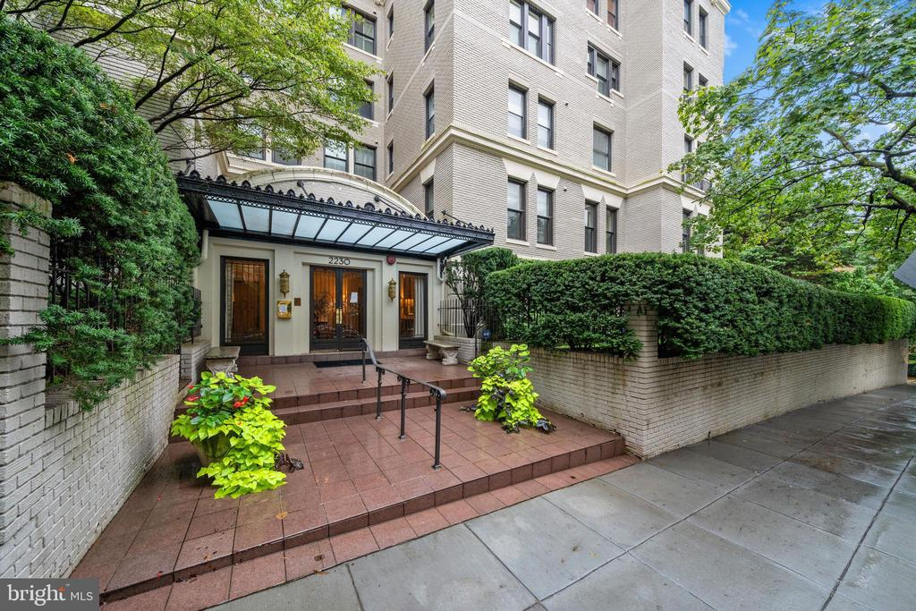 Rarely available turn-key upper level three bedroom unit with expansive and contemporary open layout at the St. Nicholas in Kalorama. This pre-war Beaux-Arts style building features historic grandeur and presence  but with desirable modern amenities . Features include three sunny exposures, two private outdoor balcony spaces (with views across the Potomac), high ceilings, a wood burning fireplace with decorative marble mantle, custom built-ins and a updated kitchen with open breakfast island. Additional deeded storage, well equipped fitness center and secure garage parking complete this offering.  Building is cat friendly only.