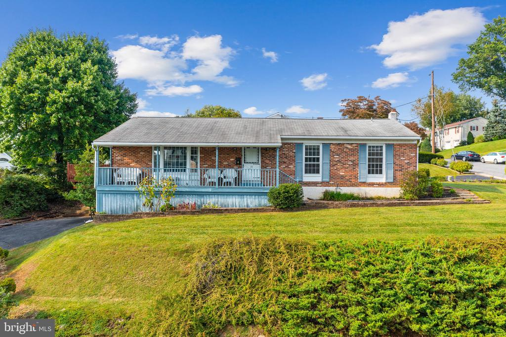 Solid 4 Bedroom, 2 Full Bath Brick Rancher in the Boyertown School District.  Sits on a corner lot with two driveways, one in the front leading to built-in garages with inside access to the home and the other on the side of the house,  leading to dual access walkways one to living room door and in the other direction, the kitchen door.  Quality built by  Moyer Custom Home Builder, this home boasts natural oak hardwood floors in the living room, dining room, and all bedroom areas.  Open beams accent the living room and dining room, off of which are sliding glass doors that lead to a large wood deck for entertaining and relaxing.  The living room is bathed in light, compliments of the large bay/bow window, bringing the outdoors in and out the front door is affixed a nice covered porch for sitting and observing your little piece of the world.   Four nice-sized bedrooms are all on this floor, the primary with good closet space, an adjoining primary bath, and a door leading out to the deck.  Located in the hallway near the other bedrooms is another full bath.  The basement is partially furnished with a family room that includes a large hearth brick gas fireplace, making for a cozy atmosphere.  Also downstairs is the laundry and room for storage, plus double garages.  Whole house fan. Inside the Boro of Boyertown, yet out of the way, close to in-town restaurants and attractions, schools, shopping, and major travel routes.  Come take a look at this gem!