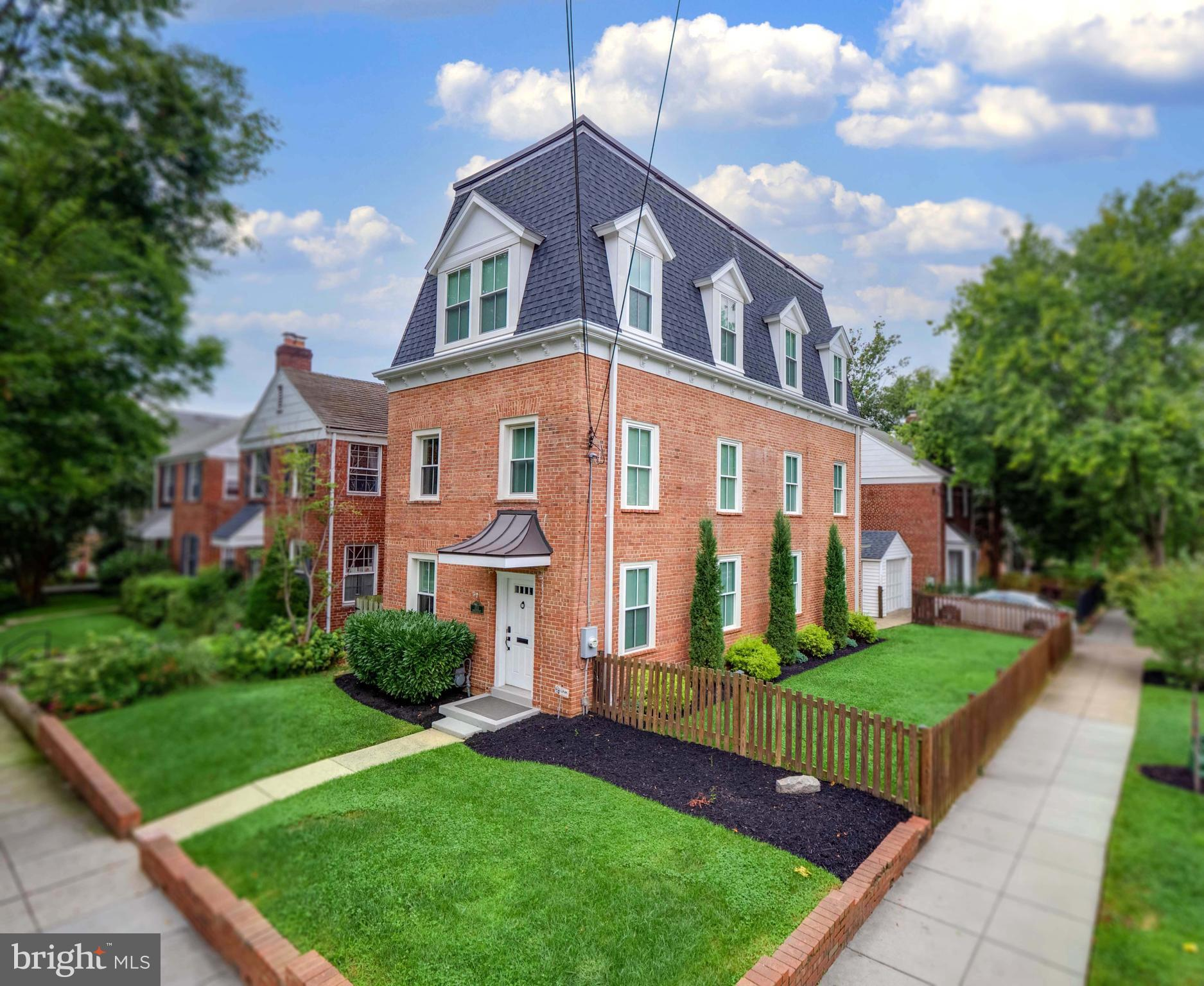 Exceptional 6BR/4.5BA Mansard-style brick home with 4 finished levels of comfortable living space, just 1 block to shops and Metro. Entirely renovated & expanded in 2016 to over 3,800sft with a new 2-story rear addition, new 3rd floor addition, and a new 570sft full-height attic above. Perched on a corner lot in the sought-after Janney/Deal/Wilson cluster, this smart home is move-in ready and designed for modern living.    FIRST FLOOR: Welcoming living room with wood-burning fireplace leads to dining area that seats 8 comfortably. Restaurant-style kitchen with Miele and Fisher & Paykel appliances, soapstone counters, 6-burner range, and two full sized sinks — one for prep and one for cleanup. Beyond the kitchen is a butler's pantry, dry bar, second refrigerator, powder room, and mudroom with rear entrance to spacious paved patio, detached garage, and exterior storage. Great flow from inside to out for grilling and entertaining.    SECOND FLOOR: 3 bedrooms, 2 fully renovated baths, ample closets, and laundry with full-size washer dryer.    THIRD FLOOR: Spacious owners' suite/primary bedroom has light-filled tree top views, generous walk-in closet/dressing room, en-suite spa bath with custom Porcelanosa shower, Hansgrohe fixtures in a dual vanity, 6ft soaking tub, supplied by a dedicated tankless hot water heater. Opposite the primary bedroom is a flexible 5th bedroom/nursery/office.    FOURTH FLOOR ATTIC: Full-height, floored attic with 570 square feet of storage, 2nd HVAC system, and 2nd hot water heater (tankless).    LOWER LEVEL: Rec room has built-in home theater with 106-inch movie screen and 7.1 Yamaha/Roku surround sound system, ready for your favorite streaming movies and shows, contained in a dedicated equipment rack. Beyond the family room is a separate 6th bedroom and full bath with private exterior entrance, perfect for an office, nanny/Au Pair, in-laws, or guest suite.    BACKYARD: Patio enclosed by privacy fence and garage, permeable pavers stay dry for