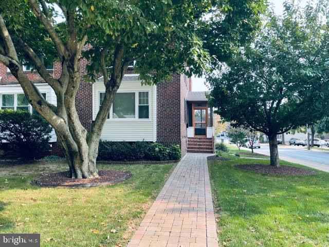 WOW!! Beautiful 3 bedrooom 2/1 bathroom brick end unit town home in the desirable Triangle area across from Salesianum High School. This fine home has hardwood floors throughout,  an open floor plan on the first floor with a large living Room and dining room great for entertaining, an updated powder room and an updated eat in kitchen. The second floor has a large master bedroom with a full bathroom and 2 more generous size bedroom and updated main hallway bathroom and a walk in cedar closet.  The finished basement has alarge family room with plenty of lighting and access to the rear exterior door and a 1 car garge.  Close to all major routes, shopping dining and only 30 minutes to Philadelphia  International Airport. Don't miss out on this Beauty.