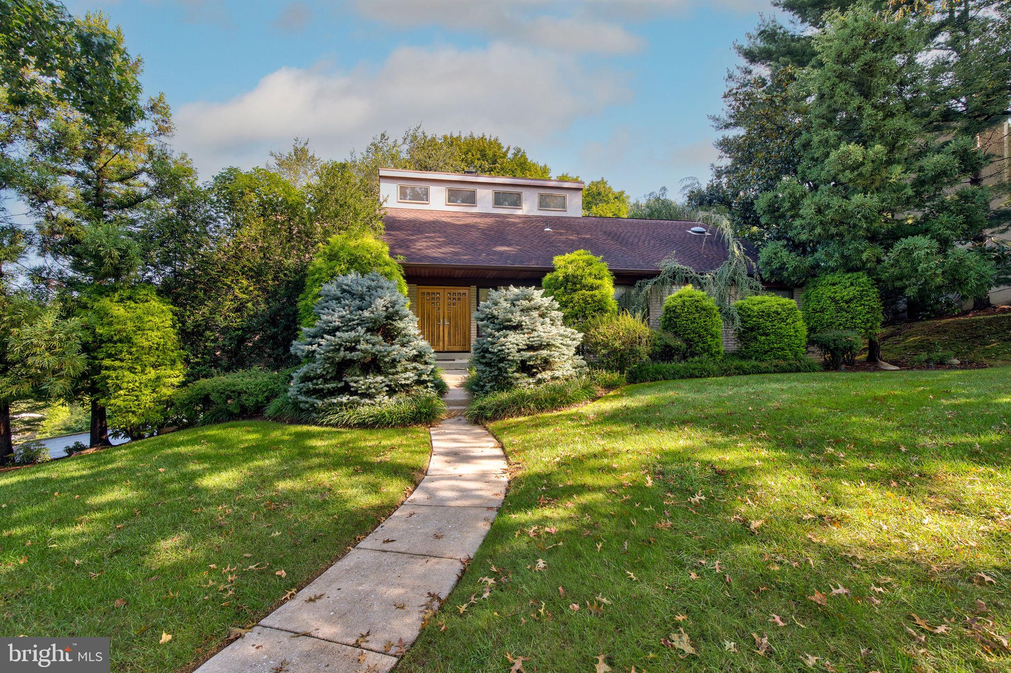 Located in sought-after Fox Fields in Bryn Mawr, this custom ranch style home has many accessible features that include an elevator, outside ramp, and modified bathrooms, all on one floor living with indoor and outdoor pools. This modern home with hardwood floors in the main living areas has a large family room with a fireplace and overlooks the pools with an outside deck for dining. The kitchen has an island and breakfast counter, all high-end appliances including a dishwasher, microwave, Sub- Zero refrigerator, trash compactor, Viking cooktop, and double sink. A formal dinning room is combined with a spacious living room for entertaining. Moving down the hallway is a powder room, laundry room, and full bath. First bedroom has good space and great closets. The master suite is a large room with built-ins, ample closets, and a bathroom with a modified shower. Connecting to the master bedroom is the 3rd bedroom that was modified and could be converted back to a full bedroom. Take a ride on the elevator to the full basement that could be a 4th bedroom or guest/in-law suite with its 2nd kitchen, many closets and storage, and full accessible bathroom. The oversized garage has room for 3 cars and plenty of yard tools and bikes. Just in case of an electrical power outage, the house has a natural gas powered generator. The outside pool area with attached hot tub offers a nice private area. This is a very special home close to the shops and restaurants of downtown Bryn Mawr, and has easy access to the Blue Route.