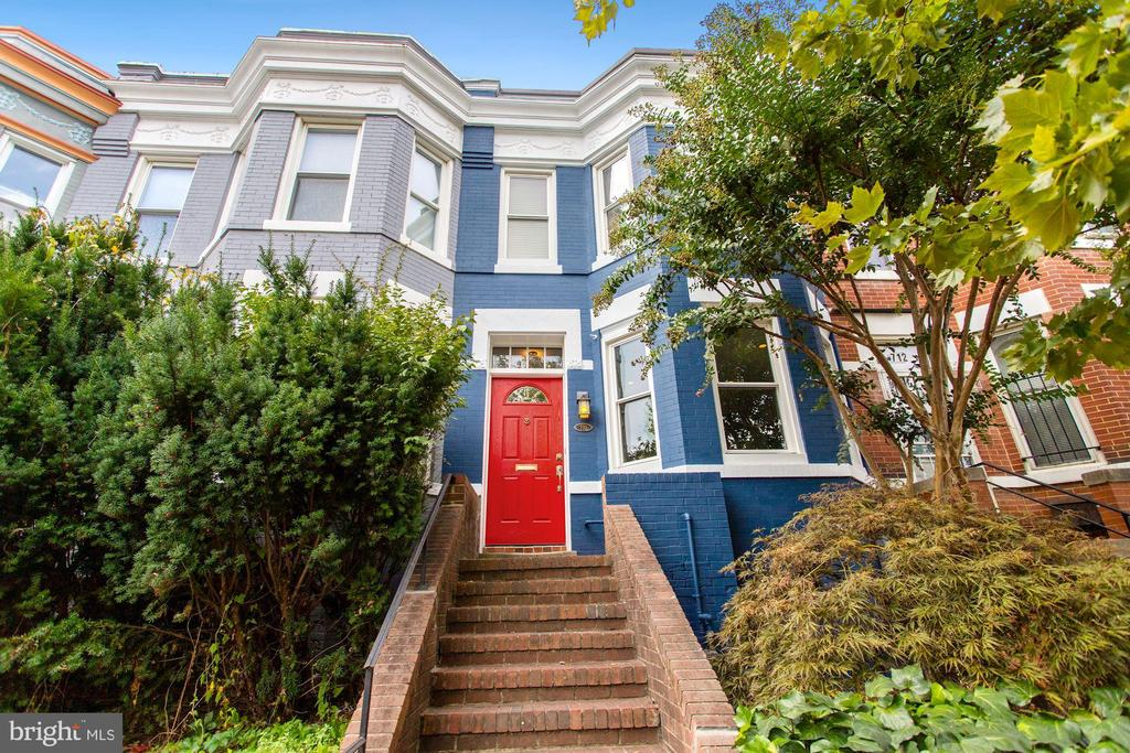 What a Charmer! This thoughtfully updated, character-rich, 3-bedroom, 1.5-bath home is situated in an ideal Capitol Hill location just steps to Union Station, Stanton Park, and H Street. Its inviting main level has separate dining and living rooms with new hardwood floors, a wood-burning fireplace and Eastern-facing, front windows. The updated kitchen has quartz counters, gas cooking, stainless appliances and abundant European-style cabinetry. Exit through the double French doors to the slate patio and private backyard where your inner grill master can cook up an enviable feast or you can enjoy a quiet drink after work. A powder room completes the main level floorplan.  Following the painted brick wall up the staircase, you'll find matching new hardwood floors, a large primary bedroom with bow-front windows, a skylight and customized closets and two additional bedrooms with ample living and work-from-home space. The upstairs bathroom has been renovated and includes a soaking tub. The elevated deck off the back bedroom offers a great spot for a coffee break. There's excellent storage both inside this home AND in the built-in shed in back. While nestled in the heart of Capitol Hill, 710 4th Street NE is close to major thoroughfares, the Metro and bus lines making commuting easy. And it's just blocks to Eastern Market and the Capitol complex. Whole Foods, Giant, and Union Kitchen grocery are just steps away as well as some of the best shops and restaurants in DC. 97 Walk Score. 99 Bike Score.