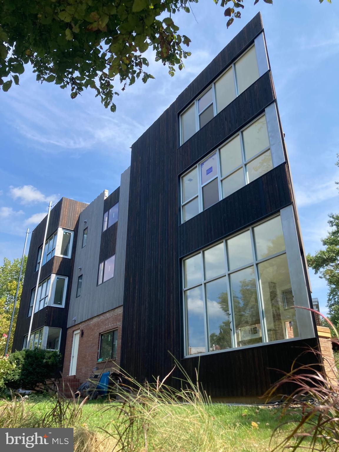 Unique brand new modern home overlooking Rock Creek Park on a quiet beautiful block next to 16th St, North of Columbia Heights, East of Petworth. Light filled 3-level corner, state of the art design, one of two side by side condos, architect/developer lives next door. Open floor plan, natural materials: concrete and hardwood floors, steel spiral stair and railings, oversized aluminum windows, porcelain tiles, quartz countertops, burnt wood siding, LED lighting. A must see for modern architecture lovers. Finishing final details.