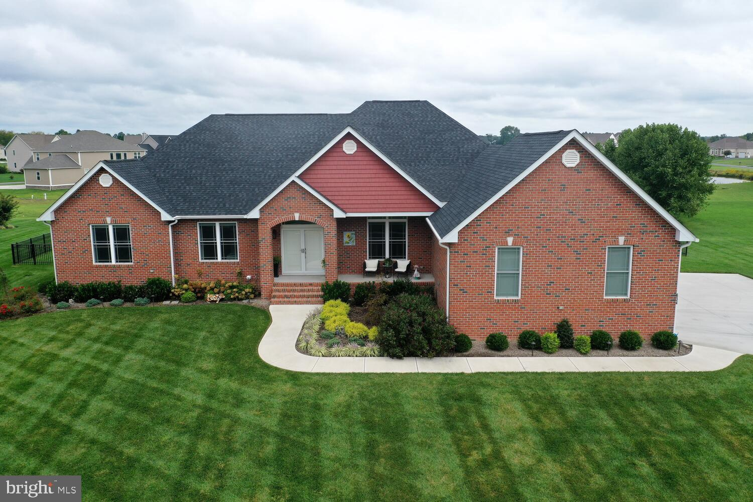 """Welcome home to 634 Estates Drive in the sought-after community of """"The Estates of Wild Quail"""".  This stunning custom all brick contemporary ranch home, built in 2019, sits on .55 acres backing to open/private space and is ready and waiting for its new owner!  As you enter through the double doors into the foyer you'll notice the unique light fixtures, which are found throughout the home.  To your left, the spacious dining room, perfect for all your holiday gatherings and get togethers.  Make your way to the bright and sunny generously sized kitchen area.  Enjoy your morning coffee in one of the two sunrooms the home has to offer.  Other kitchen amenities include, granite counter tops, 42"""" soft close cabinetry, large island with seating for four, built in office nook and convenient laundry/mud room w/ utility sink.  Just off the kitchen you'll find the family room w/ gas fireplace and living room.  Both rooms offer trey ceilings w/ an abundant amount of recessed gallery lighting and ceiling fans.  Step through the sliders into the inviting, second sunroom overlooking the well-manicured fenced backyard.  Spend your evenings relaxing on the concrete paver patio enjoying the warmth of a cozy fire. Located on the opposite side of the home, the sizeable master bedroom offering a sitting area, walk in closet, trey ceiling w/ recessed lighting, large private bath with 6' whirlpool jetted soaker tub, tile and grout shower, double bowl vanity and separate water closet with added single bowl vanity. Two additional bedrooms and full hall bath w/ cast iron tub, glass shower doors w/ tile and grout shower walls and flooring plus another half bath complete the main floor of the home.  If you find you're in need of even more room, make your way to the enormous, finished basement, which offers another approximate 3600 square feet of livable space. The massive 30x19 bedroom w/ double closets and egress window offers comfort and privacy for your guests with access to an additional fu"""