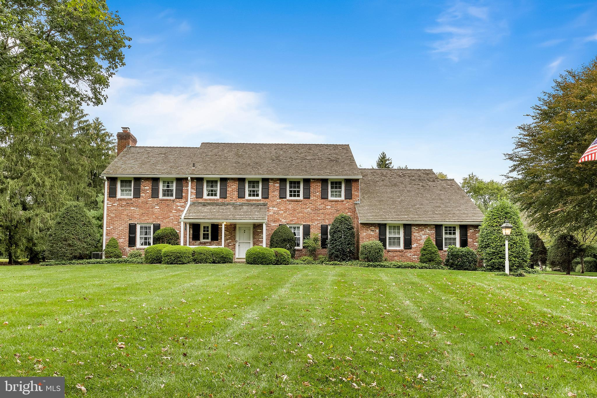 Nestled upon one of Tredyffrin Township's most desirable streets, welcome home to this traditional five bedroom colonial. Sprawling across a serene lot with a beautiful brick facade, 1893 Fox Hill Lane is filled with charming features, an efficient layout, and a spacious backyard with an in-ground pool.  Enter into a light-filled main level showcasing brick and wood floors and many oversized windows. A living room with a wood burning fireplace, a powder room, and a formal dining room are located just off of the foyer. A quaint den with paneled wooden walls leads to the gourmet kitchen boasting ample wooden cabinetry, granite countertops, and a breakfast nook with a light fixture. Nearby, you'll find a generously sized home-office and a second half bath. Ideal for curling up with a good book or spending time with loved ones, a bright and cheery sunroom offers several walls of floor-to-ceiling windows, brick accents, and a cozy brick fireplace. This space is truly magnificent for watching the seasons change and provides direct access to the lavish backyard with an in-ground pool and a shed.  Five generously sized bedrooms can be found on the second floor, including a spacious primary suite with several windows and an ensuite bathroom. Bedrooms 2 & 3 enjoy use of a full hall bath, while Bedrooms 4 & 5 share a jack-n-jill bathroom. Additional highlights include an attached 2-car garage and an unfinished basement, ideal for storage. With potential to move  right in or customize this lovingly cared for residence to your tastes, come see all that this property has to offer.  Minutes away from many parks and biking trails, wonderful schools, and local Main Line businesses, residents enjoy a highly coveted location. Easy access to the Paoli train station, Rte 202, and the PA Turnpike make commuting a breeze.