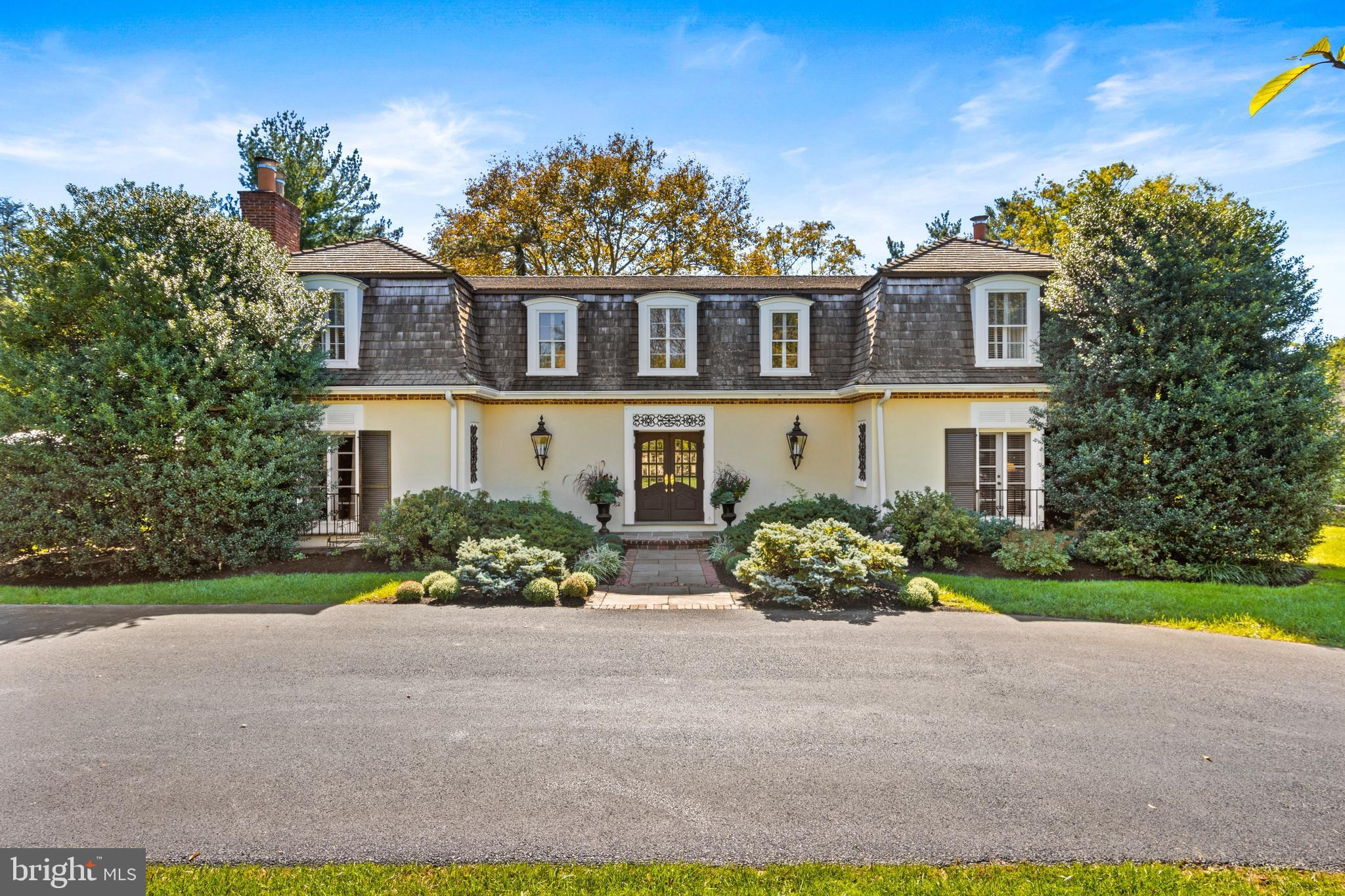 Elegant French Colonial home located on one of the most sought-after streets in Radnor Township. This gracious home is both stunning and charming with over 6,000 sq. ft of living space. Escape the city and find serenity in this ideal oasis for family living and working from home with two, separate designated office spaces, limitless indoor and outdoor living and entertaining spaces in a highly walkable neighborhood.  Very rare all 5 bedrooms and 5.1 full baths are on the same floor, perfect for larger or extended families. Dramatic custom split staircase and two-story foyer, gleaming hardwood floors, eat-in kitchen with stainless steel appliances with beautiful views of the pool and exterior spaces.  Living room with fireplace and French doors to the large patio, large, formal dining room, perfect for entertaining. Family room with fireplace, perfectly located next to the kitchen.  The expansive second floor features all 5 bedrooms and baths and a bonus great room with vaulted ceiling. The primary bedroom is highlighted by a new, marble bathroom and separate dressing area.  Every sun-filled bedroom is generously sized with renovated/updated bathrooms. In-ground, heated pool, expansive patio with new awning, circular driveway, 3-car garage. An unbeatable Main Line location situated in the award-winning Radnor Township School District near shops, restaurants, and the Radnor nature trail.  Close to 76, a quick drive to Center City or the airport.