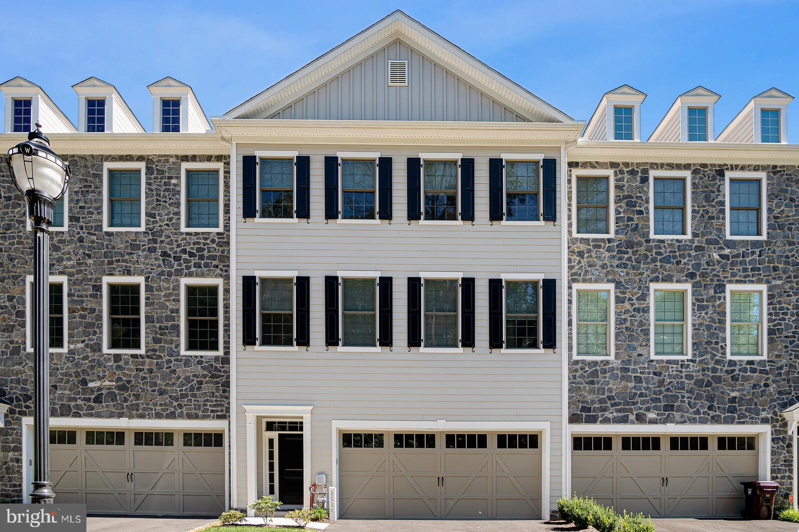 Savor the tranquility of the Brandywine River views and the convenience of living in the Highlands! This stunning home offers easy, walkable access to all the best features of both. Coupled with your very own private drive & garage you'll never have to worry about where to park! Built in 2019 by Montchanin Builders, this 3-story townhome is superbly constructed and designed with numerous upgrades throughout! The great room design offers the popular open concept with 10 ft ceilings, crown molding, and beautiful upgraded hardwood flooring throughout. The gourmet kitchen offers quartz countertops, stainless appliances, pantry, and an oversized 12 foot island with ample seating. There's a perfectly sized pocket office located off the kitchen, charming powder room and great room gas fireplace plus glass slider to a Trex composite deck facing east with views of the river (and stunning sunrises)! The spacious 3rd floor main suite has crown molding, luxurious bathroom with gorgeous tile, double vanity, upgraded frameless glass shower, and 2 walk-in closets, 1 that has been customized by Taylored Living into a dream closet. Two more bedrooms and full bath plus a laundry room complete this level with 9 ft ceilings. The main level offered 9 ft ceilings, access to the 2-car garage and a bonus space that can be finished to add more living space. Last but definitely not least, the basement comes equipped with an egress and plenty of storage.  Custom lighting, motorized blinds, hardwired Ethernet in family room/all bedrooms, and chic but neutral colors complete this amazing home!