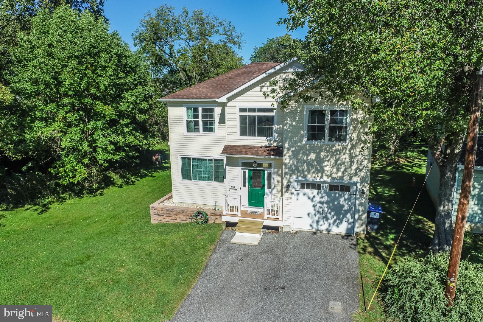 """Great location and great lot backing and adjacent to open land in Brookland Terrace.  3 beds, 2.5 baths, with a 1 car attached garage.  Hardwood floors and 9 ft ceilings on the first floor.  Living room has a large picture window and a gas fireplace flanked by two smaller transome style windows to allow for an abundance of natural light.  The kitchen is huge with 42"""" maple cabinets,  separate pantry,  gas cooking,  built in diswasher,  refrigerator, and microwave.  There is also bar counter seating and a separate dining area.  Access the deck through sliding  glass doors and enjoy a spacious seating area and room for a grill perfect for entertaining,  There is also a firepit on the side yard perfect for the upcoming Fall weather.  Upstairs are 3 spacious bedrooms with excellent closet space.  The primary bedroom has a large walk-in closet  as well as a 3 peice bathroom with private access.  All energy efficient windows and noise reducing insulation between floors and bathrooms.  Brand new carpet installed on the entire second floor 1 week ago.  New high efficiency HVAC systems in 2020.  Washer & dishwasher were also replaced in 2020.  Gas water heater in 2019.   Full unfinished basment with poured concrete foundation and proper egress installed perfect for finishing to add additional living space.  All appliances included.  This house is turn key and in move-in condition!"""