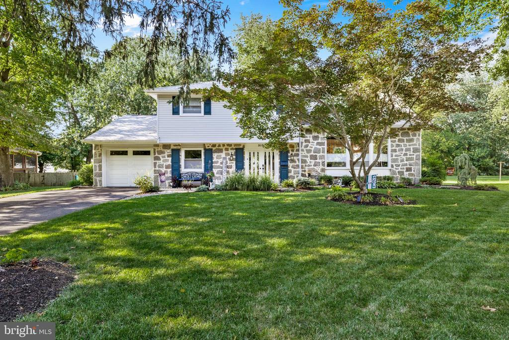 Welcome home to this gorgeously renovated gem in Cinnaminson! This beauty has been completely updated from top to bottom within the last 3 years so there is truly nothing to do here but unpack and enjoy. When you enter into the foyer, you will walk into the oversized family room with a white-washed brick wood burning fireplace, newly updated powder room, laundry room plus access to both the garage and basement. The large unfinished basement had a brand new french drain and sump pump installed only three years ago and is an excellent space for all your storage needs or it can be finished for additional living space. Back through the foyer, it's just a few steps up to an entertainer's dream. The open concept floor plan includes the kitchen, dining and living area that shines bright with natural light from the large front bay window. You'll appreciate the charm of the original hardwood floors that have been restored to a dark, beautiful finish. The custom designed kitchen is equipped with a Viking gas range, custom hood, expanded quartz counter tops, oversized porcelain farm sink and herringbone pattern marble backsplash. The stunning center island with marble shell pattern inlay provides additional storage as well as access to the microwave. The dining area opens to the deck that is complete with strung bistro lights and overlooks the luscious back yard for the perfectly relaxed setting. New landscaping and a successfully established vegetable garden are just added bonuses to this back yard retreat. The upper level of the home hosts 4 bedrooms and 2.5 bathrooms. The main bedroom suite includes its own full bath and one of the 3 bedrooms has its own half bath as well. Newly installed insulation and draft block has been added in the attic and the homeowners even extended the driveway to allow for more off-street parking. You will see total pride of ownership from the moment you walk in. This is truly one you don't want to miss.   ***Per sellers' request, home will be av