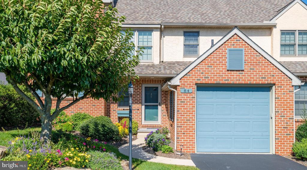 In beautiful Summerfield at Elverson in the northwestern corner of Chester County, this two-story center townhome, with its open floor plan,  has been beautifully maintained.  The large updated kitchen, which overlooks the dining room (with bay window), has quartz counters, tile backplash, a stainless undermount sink and new appliances. A 3 panel french door leads to a generous deck in the back.  The attached one car garage is convenient to the main floor.  Hardwood floors cover the entry, dining room and second floor foyer and all bedrooms. The second floor is complete with 2 guest bedrooms, a guest bath and a vaulted master suite with a double bowl vanity, whirlpool tub and a separate shower/toilet room.  The basement has a family room finished in 1999 and space for storage.  Stoltzfus-built, this home is heated and cooled with energy-efficient geothermal and has a pre-cast Superior basement wall system.  The roof was replaced in 2020, the geothermal unit  in 2012 and the hot water heater in 2019.  HOA fees which are $1000/year cover lawn care, snow removal (to the garage door) and common area maintenance.  The capital improvement fee upon purchasing is ZERO.  Summerfield is a lovely pasture-lined community of 320 town and single family homes in the northwestern corner of Chester County in the quaint pedestrian-friendly town of Elverson.  Join others who love safe, quiet and friendly country living.  Want convenience?  A Walmart Plaza and the Morgantown turnpike exchange are only minutes west in Morgantown.