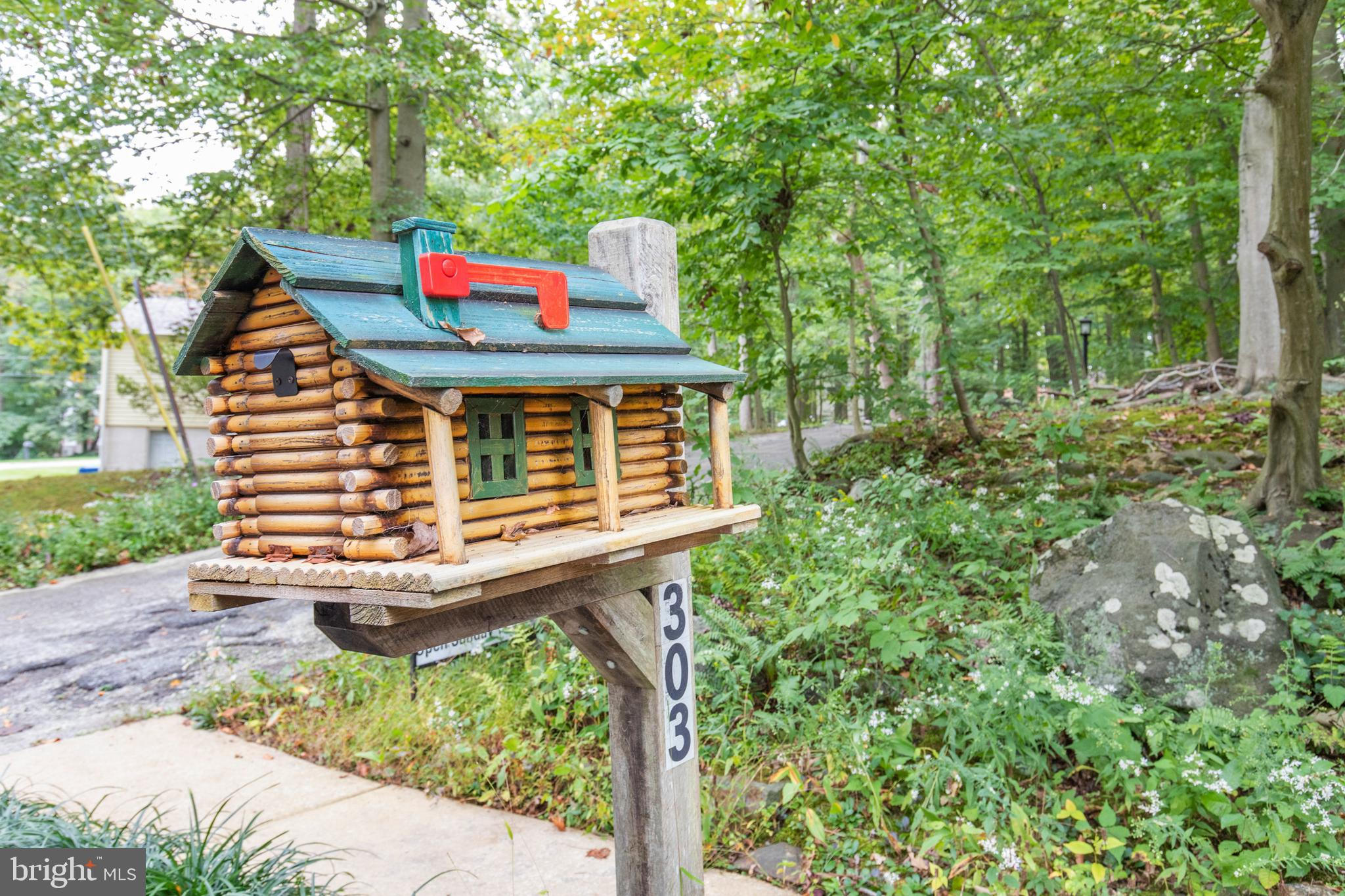 Welcome to this unique log cabin home built by Ward Cabin Company in highly sought-after community of Arbour Park.  This charming, private home is nestled in 1.13 acres of wooded property.  It's like living in a serene mountain resort with all the conveniences of Newark nearby.   As you enter the home you will see the open concept living room, dining room, family room and kitchen overlooking the lovely wooded terrain. The kitchen features new black appliances and open to the family room and dining room. Just down the hall are three bedrooms with ample closet space and hardwood floors throughout.   Also on this level are two full bathrooms as well as another room which can be used as a bedroom or home office next to the family room.  The gorgeous stone wood-burning fireplace offers warmth to the living room and the second fireplace is in the family room. Laundry room is also on the first floor. You then go upstairs to the full spacious attic offering additional living space and storage.  The partially finished basement on the lower level is where you'll find additional living space and the third fireplace - perfect for entertaining and recreation and access to the two-car garage.  HVAC has 3 zones.  Just out the door from the kitchen are the patio and wood shed with access to the inside wood box.  This property encompasses 3 lots in total and offers a community pool in the neighborhood. Put this log home on your tour today and celebrate the beauty of all seasons!  This property is conveniently located within walking distance of Rittenhouse Park and in close proximity to the University of Delaware, great restaurants, I-95, shopping and 17 miles of trails through all the New Castle County Parks.  This amazing property has so much to offer and being sold As-Is!