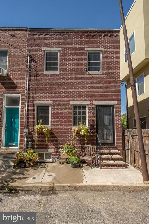 Welcome to 1150 S. Clarion St. in the heart of Passyunk Square. This stunning home is truly a work of art and is situated on a lovely cul de sac full of foliage and is perfect for the individual that wants the energy of the city while offering the seclusion of a peaceful low traffic street.   This home offers a 16 foot wide front and major square feet which provides such a spacious and comfortable vibe that is rare in most row homes.  We begin with stunning curb appeal featuring a contemporary modern brick front and window planter boxes that glisten in the beautiful natural light that this house presents. Very ample and spacious floor plan that consist of beautiful custom oak hardwoods floors throughout , cutting edge and thoughtful accents of custom crown and chair rail millwork and geometric tile accents . The first floor consist of a wonderful family/living room with custom built-in shelving and entertainment center with high ceilings and custom accent lighting, this flows perfectly into a grand dining area that is just asking for a dinner party!  The modern chef's kitchen shines and is well equipped to cook a feast and consist of surround contemporary shaker cabinets, high end granite countertops that extend to create café seating, handmade subway tile backsplash, Pantry shelving Elfa system, under-cabinet lighting and high end stainless steel appliances. Custom sliding doors open to a private and huge backyard patio with a breezy tree and perfect landscaping, this is going to be your oasis no matter what season, it is finished with a high fence and deck floors for totally privacy and finished look. Grand staircase leads you to the 2nd level that is awesome and is home to 3 bedrooms and 2 full baths, Master bedroom is luxurious with surround walk-in closets, storage shoe cubby,  Artemide bedside lights and custom windows that draw the natural sunshine. Master bath and shower is tastefully done with porcelain and mosaic tile finishes, new vanity, custom LED mirro