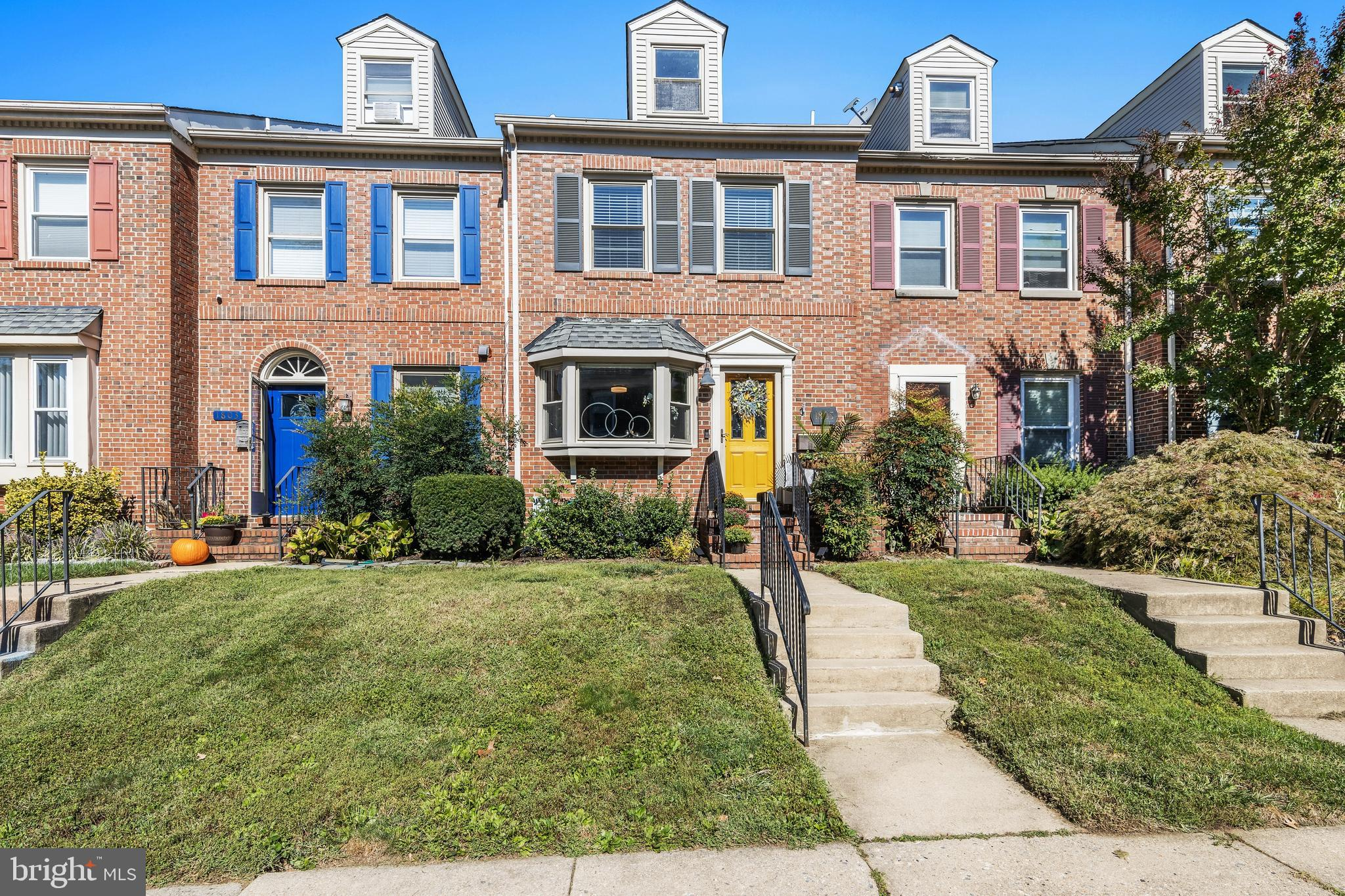 """Welcome to this extraordinary 3 bedroom, 2.1 bath (+ a 1 car garage) brick townhouse that has been REDUCED! professionally updated throughout : Notice the expanded opening into the chef's kitchen (features include 42""""grey painted cabinets with quiet close feature, quartz countertops, subway tile backsplash, stainless steel undermount extra-depth sink with designer faucet , on trend hex tile floor, Kitchenaid stainless steel appliances - smooth-top range, build-in microwave, dishwasher, side by side refrigerator with icemaker - & of course a wine cooler!! Thanks to the triple bay window  this kitchen is bathed in natural light, but like the hallway boast an upgrades ceiling mount light fixture. The open dining room & living room was designed for entertaining or just cozy evenings at  home. Featuring hardwood floors, a wood burning fireplace (seller will graciously leave the TV mount over the fireplace) & sliders to the enclosed & private deck (which also has an entrance to the one car garage). Rounding out the first floor is a hall closet & a powder room (note: the tax records do not indicate that there is a PR, but it is just to cute to overlook - new vanity, mirror & lights + the wallpaper is peel &stick, so very easy to change out!!)  SECOND FLOOR Owners Suite - located in the front of the house -  generous size, 2 double closets, upgraded carpets, ceiling fan & professionally designed Bath (with a barn door!!!) new vanity, lights, tile floor & shower + a linen closet Guest bedroom - located at the back of the house - generous size, with oversize closet & access to hall bath which features a shower/tub combination  Rounding out the second floor is the laundry room complete with storage space  THIRD FLOOR - features a third bedroom, but current owners  have used it as office space (something that has come in handy this past year), extra bedroom & exercise area (sellers will leave window air conditioner which comes in handy when working out there!!) The whole house """
