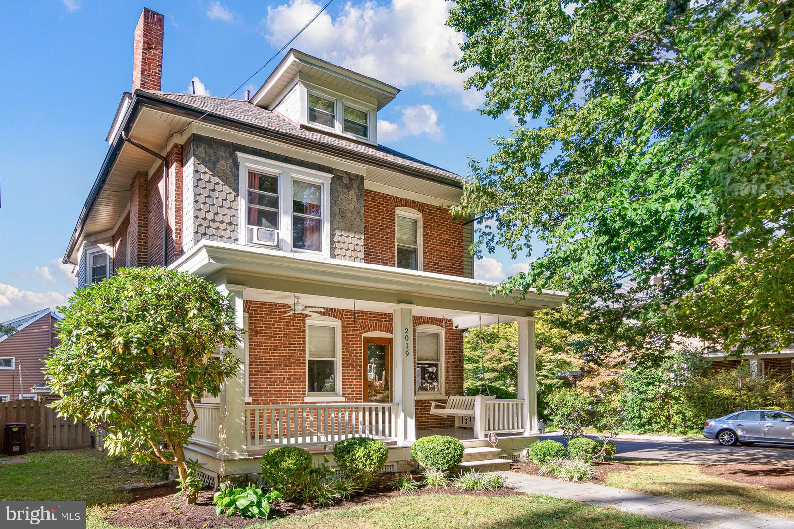 This rare opportunity to purchase a single family detached home in this location won't last long.  3 story brick classic has been professionally designed and decorated.  Every detail has been carefully considered to reflect today's modern flare while maintaining the original character of this wonderful home. In the past several years there have been over $75k spent in upgrades.  Hardwood floors throughout, custom inset cabinetry with stainless appliances, quartz countertops, original clawfoot tub on the main level and much more. The 2nd floor has 3/4 spacious bedrooms and 1 full bath. There is even a 3rd floor with a large bedroom and walk in attic for additional storage as well as an ac/heat mini split system. The outside is complete with beautiful landscaping and stone patio with a privacy fence. Unbeatable location close to all major roads, restaurants, and shopping. A great place to call home.