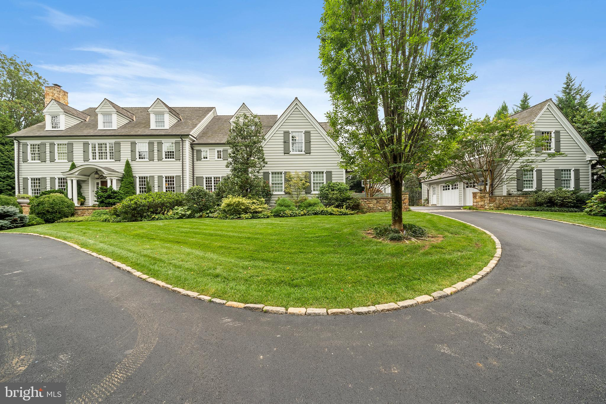 """A cool, 'New classic' w/ one of the most well-considered & smartly delivered interior plans in arguably the most highly prized location in all of Radnor township. 25  Orchard Lane, offers the hard-to-achieve blend of warmth through expertly selected finishes such as character grade flooring, hand-hewed beams, reclaimed wood doors as well as engaging contemporary elements including large format tile, chic lighting & bright connected spaces. A generous fireside formal LR & elegant DR flow from the wide Center Hall. Fully paneled, & positioned off the back of the house a handsome Library/Office glows with an embedded saltwater aquarium on one wall & a gas fireplace on the other. Cross the  Foyer & Hall to the stunning custom Kitchen, Breakfast Rm & vaulted ceiling Family Rm. In the Kitchen, rich, contemporary profile cabinets & stone counters meet the slightly iridescent backsplash creating a sophisticated but immediately welcoming space. A suite of highest level appliances (double Wolf ovens, two Bosch dishwashers, 6 burner Wolf gas cooktop, Sub-Zero refrig &freezing) forms the perimeter, surrounding a spectacular oversized seated island. Additional storage & utility are found in the Walk-in Pantry, another wall of cabinetry & under-counter wine chiller. Steps away & brightened by custom windows & french doors, the Breakfast Rm features a peaked ceiling  & opens to a dramatic Family Rm w/ floor to ceiling stone fireplace, custom shelving & outside exit to the sweeping rear stone terrace. W/ an eye towards organization & demand for at-home workspaces, 2 different Family Offices are located off the Mudrm/Garage entrance. One office is designed w/ two desks on either side of a wide window & the other enjoys views of the Courtyard & features a custom dog door & walk-in closet, ideal for concealing printers & supplies. A full Laundry w/ dog bath, Costco-sized storage closet & """"Bike room"""" from the attached  2 car Garage underscore the superior & informed design of the home."""
