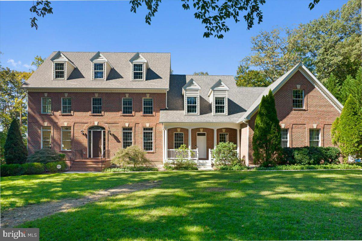 There is nothing typical about this gorgeous waterfront home! From the quality of construction, the exceptional 5/6  bedroom  floor plan, the 4+ car garage to the Trex walkway to the waters edge, you will be enchanted!  Walking up the brick stairs, you enter this stately colonial with 10 foot ceilings, an abundance of trim work and lovely hardwood flooring. You will even have two separate rooms for his and hers office spaces, or use one as a main level bedroom with closet and attached full bath already in place.   With much forethought, the main level has a half bath off the entrance to the garage , a second stair case off the kitchen to the bedrooms and a full bath at the other end of the home.  Views of the Patuxent can be seen from a far in the great room as well as the screened porch off the kitchen.  Moving up to the second level ,  you will find the owners suite with balcony and views of the River as well as 4 other bedrooms,  2 Jack and Jill Baths and a separate hall bath.  A newly finished lower level features a wet bar area, huge recreation room and a full bath as well as a study or another bedroom. Now for another magical part of this home, let's take a walk outside. Go for  a leisurely stroll down the long Trex pier  to the water's edge of Lyons Creek.   It is one of the most relaxing experiences you will ever  have.  It is easy to walk out from your back yard and you  will be able to  see nature in all it's glory.  As you stroll the pier  , you will see cat tails, beautiful flowering  greenery, birds flying around and chirping,  the melodies of the many frogs and  a sense of  serenity that  will bring you to a different place and time.  You can not help but relax when you  watch the evening sunset or start your morning with a magnificent sunrise.  This is truly how to experience the water of the Patuxent to it's fullest. Located on Lyons Creek which flows directly into the Patuxent River.   Perfect for kayaks and canoes.  You can use the community ramp f
