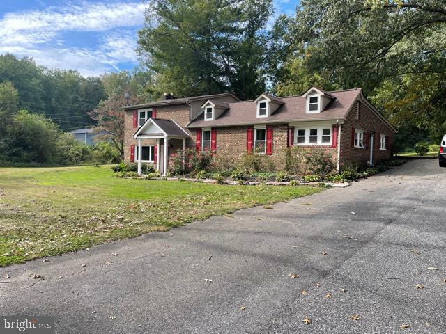 This over 2300 sqft home features all brick; split level, with  3 bedrooms, and a loft which could be used as a fourth bedroom, 2 full baths, 2 car detached garage all on 1.88 acres, including a creek.  The property is located between 301 and to Rte 210, minutes from NSF Military facility. Home is on holding tank,  Roof 10 years, HVAC 10 years, Kitchen has granite, and stainless appliances, wood floors throughout, fireplace, sump pump, crawlspace, and plenty of parking,  Pool is not operational.