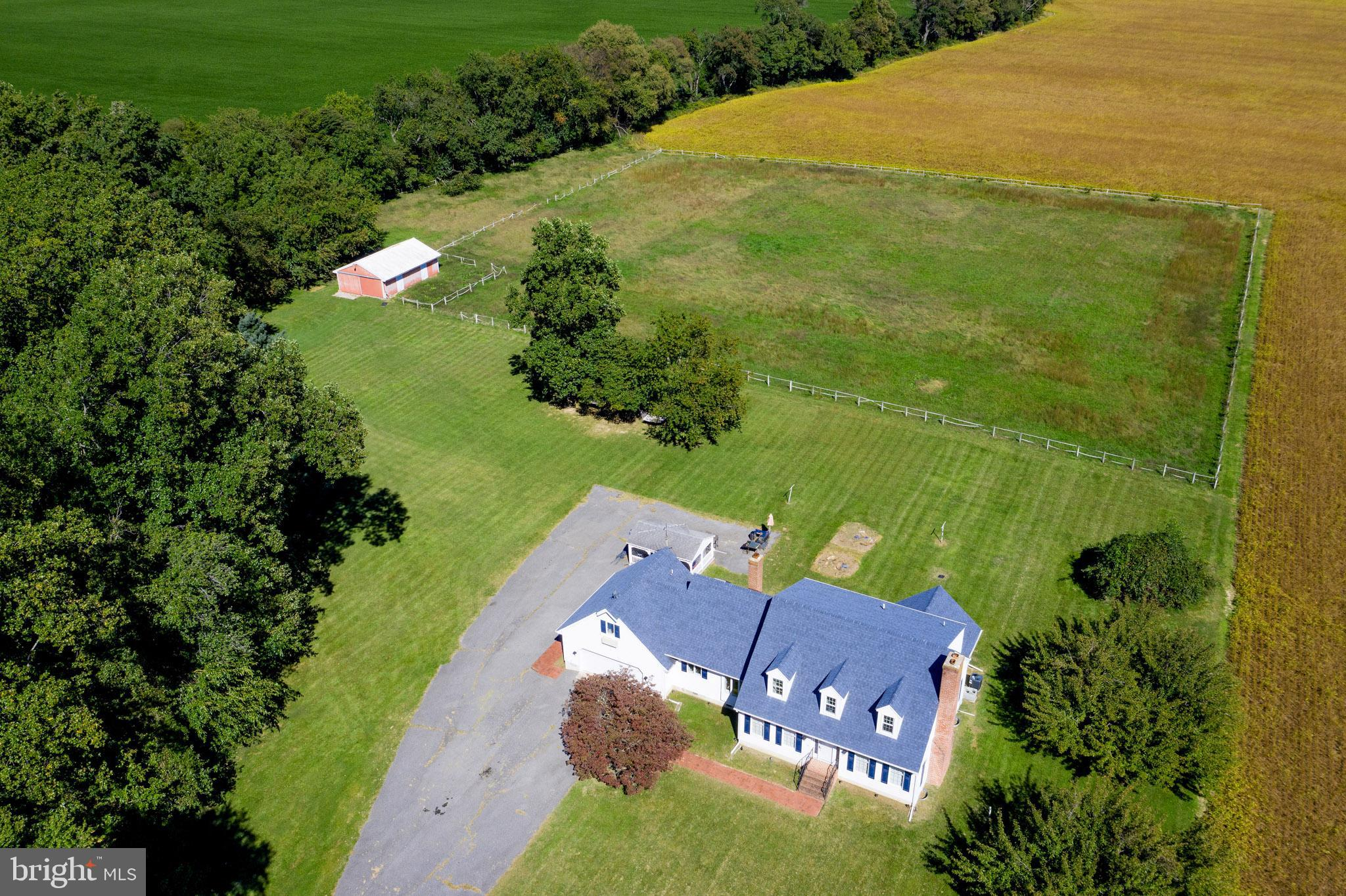 Welcome Home... This wonderful Home sits on 5 cleared Acres and is accompanied by 2 pastures and a 3 Stall Metal Building. Come on in... The beautiful wood floors & staircase will wow you upon entry! The kitchen is a cooks delight, as it has all of the upgraded finishes including soft close cabinets, granite countertops, luxury vinyl and stainless steel appliances. Off of the kitchen you will find a great sized  dining room with built ins. Both the living room and family room are equipped with wood burning fireplaces to keep you cozy in the winter. There are beautiful exposed beams that run the length of the family room. Kick back and enjoy the views of your pastures from your 4 seasons room, which sits right off of the main floor office. Upstairs you will find the 3 bedrooms, the Primary has a private bath. Bonus...  tucked away over the Garage there is a room & full bathroom - Wow! The basement is wide open and ready for you to make it your own. So, I have to ask...  are looking for space & privacy with the convenience of close shopping... Then look no further!  Call for your showing today :0)