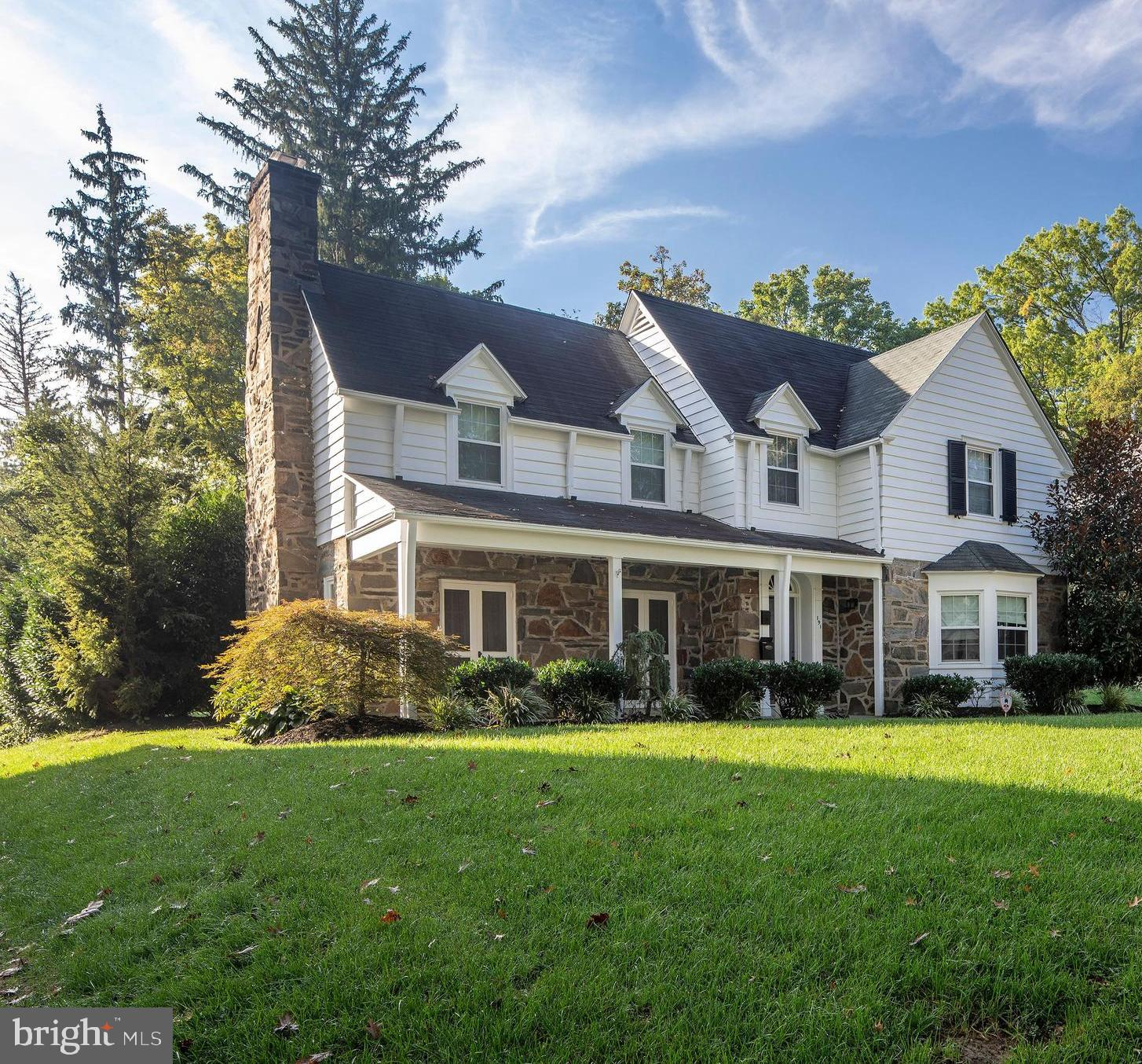 """Experience the best of the Main Line in this stunning, sun-drenched, historic stone colonial located on a lush level lot on one of the best and most secluded blocks in Ardmore. Lakeside Road is located on the Ardmore/Wynnewood border, offering ideal walkability to Whole Foods, the shops and restaurants of Ardmore (and Wynnewood), South Ardmore Park, and the Wynnewood train station, but also offering a Wynnewood """"feel,"""" surrounded on all sides by stately historic homes and mature trees.   This exceptional classic Main Line home offers the finest original interior finishes (including hardwood floors throughout, soundproof plaster walls, exceptional millwork, high ceilings, and a grand living room fireplace) combined with excellent kitchen, bath, and system upgrades, resulting in a complete and unparalleled lifestyle.  At the end of a hectic day, open your door and experience space, tranquility, light and flow. Entertain with pride in your gourmet granite/stainless chef's kitchen, in your spacious formal dining room highlighted by bay windows and French doors, in your ample family room featuring additional French doors overlooking your private back yard, or in your living room featuring a massive fireplace and two more sets of French doors. On warm summer nights, host barbecues on your classic blue flagstone patio and enjoy quiet conversation and birdsong. On cold winter nights, snuggle up to your grand stone fireplace and enjoy a good book, intimate conversation, or binge-watching your favorite tv show. In the evenings, stroll the rolling hills of Wynnewood and enjoy an ever-changing vista of stately historic homes unfolding on all sides.  Enjoy the perfect location offering prime walkability, secluded green spaces, a 10 minute commute to center city Philadelphia, and the renowned Lower Merion School District."""