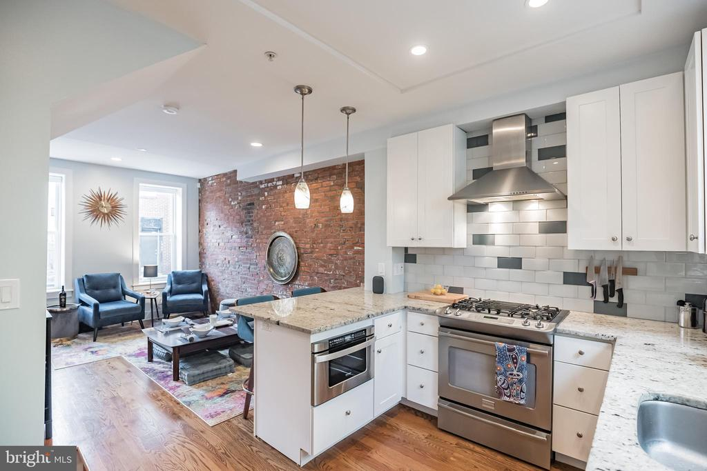 Lots of exposed brick and stone walls in this stylish home for sale in Philadelphia with 3 bedrooms, 2 bathrooms, roof deck, large back patio, and 1440 Square feet plus a finished basement with additional square footage. On the first floor of this home is an open floor plan with a living/dining area, a fully equipped chef-style kitchen with granite countertops, a tiled backsplash, a breakfast bar, and a pantry cabinet. The sink looks out of a large window and into the spacious back patio with southern exposure so it's very sunny! Downstairs is a finished basement with beautiful stone walls and radiant heated tiled flooring. On the 2nd floor, there is a hall bathroom with a tub/shower combination a front bedroom currently used as a home office and guest bedroom, and a back bedroom. The third floor features the main bedroom suite with high ceilings, large windows, and ensuite bathroom with beautiful custom two sink vanity and a large walk-in shower with glass tiles. The main bedroom suite also includes a big walk-in closet and a separate laundry closet with a full-size stackable washer and dryer located in the hallway. Going up one more level you will enjoy the roof deck with great views of the area and moonlit nights. This home has several smart switches/outlets and well as smart blinds in the main bedroom.  From this location in the Bella Vista neighborhood, you are a short walk into Center City and many great restaurants. It's also easy to access to the Broad Street subway line. Walk to Sprouts Market, the Wine and Spirits store, Target, and the Pet store.  Schedule a tour today and get ready to move. The remainder of tax abatement transfers with the home. Move-in, Unpack, Enjoy!