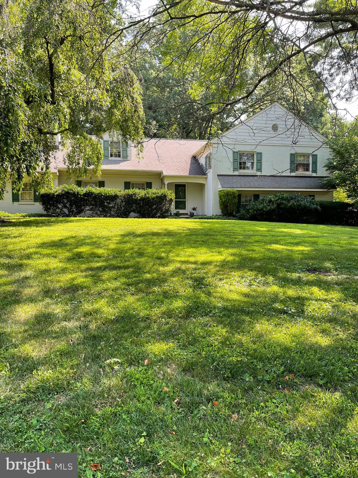 Beautiful Bryn Mawr Split Level in Lower Merion Township featuring five Bedrooms, three and a half baths is waiting for you!  Bright and sunny Main floor offers Foyer with coat closet, spacious Living Room with wood burning brick fireplace, formal Dining Room all with Crown Molding and hardwood floors.  The very large Eat-In Kitchen boasts Corian countertops, granite island, a stainless steel Thermador gas cooktop, a stainless-steel counter depth LG Refrigerator, a LG Microwave, a Thermador Convection wall Thermal Oven, a stainless steel Kitchen Aid Dishwasher, with sliders that open up to a flagstone path leading to a beautiful rear yard, flagstone terrace and covered patio.   Upper level 1 offers a wide Hallway, Primary Bedroom with ceiling fan, Dressing area, 2 main closets, built-in vanity and a Primary Bath with stall shower.  Hall Linen Closet, Hall bath with updated sinks and faucets, and laundry chute, two additional Bedrooms all with ceiling fans, and hardwoods complete this level.   Upper level 2 includes a walk-in attic off the hallway, Bedroom 4 includes steps to an additional fully floored attic with a new attic fan, Jack and Jill Bathroom, and Bedroom 5 includes two sets of built-in drawers, and hardwoods complete this floor.  The attic storage is endless!! Finished Lower Level offers a large walk-in closet, Family Room with a second over-sized walk-in closet, Powder Room and slider to rear covered flagstone Patio.   No steps to a full unfinished basement with crawl, Laundry Room w/Laundry Chute and outside exit.  Central Air, Gas Heat, a two car Garage and more!!